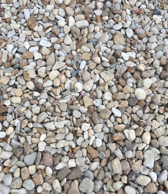 Different size river rock can make a main feature for your landscape and IT can also make a great material for drainage.