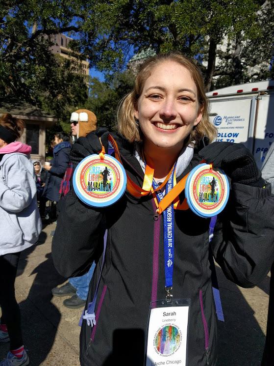 Sarah ran the half marathon and got two medals!
