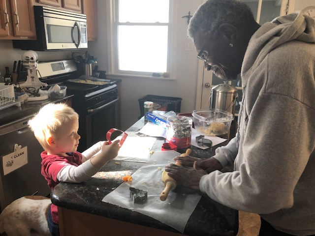 Elbert and Wilson making cookies together.