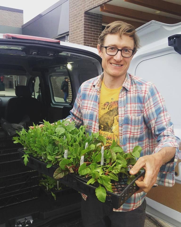 sean with seedlings.jpg