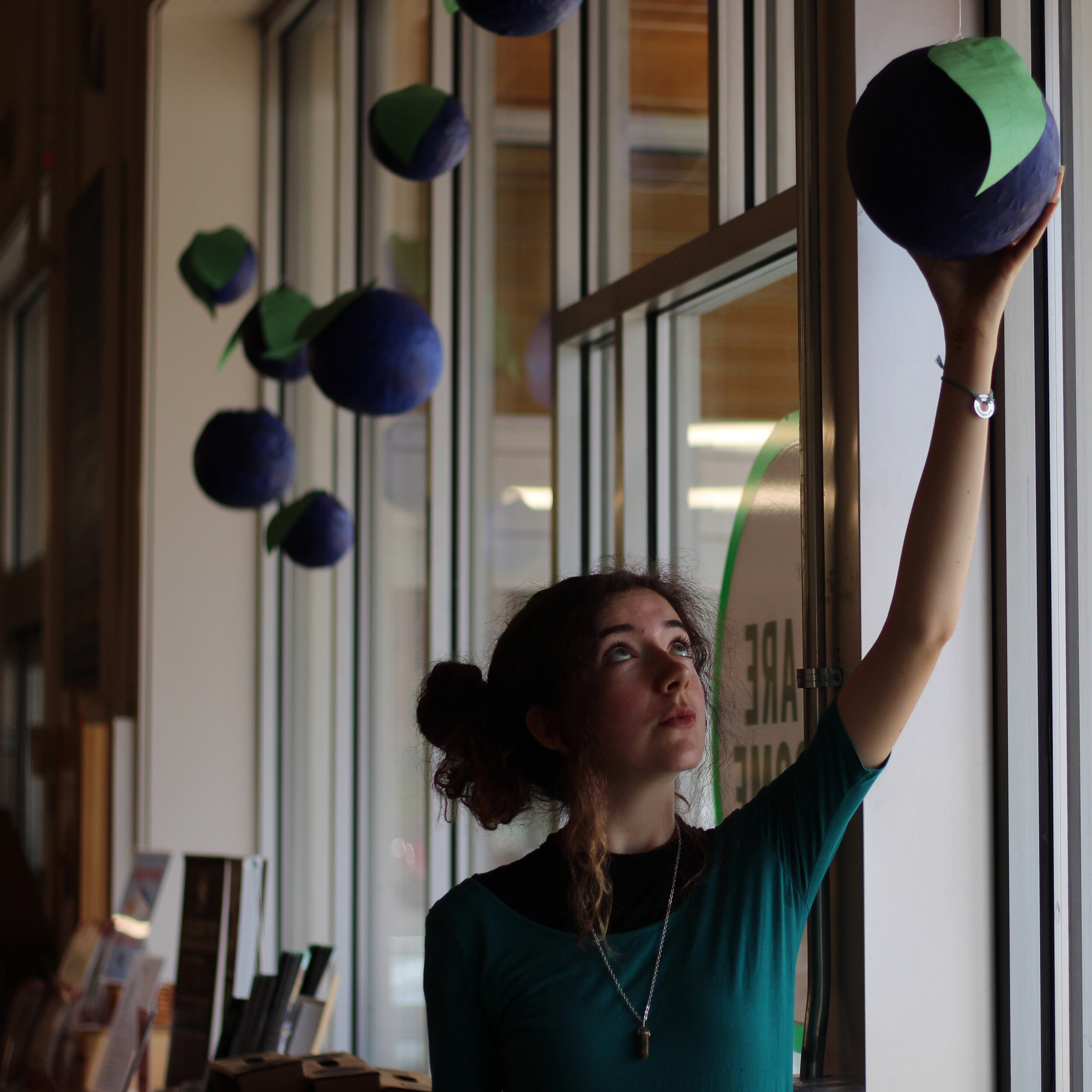 Ceiba Crow with her blueberry art installation,