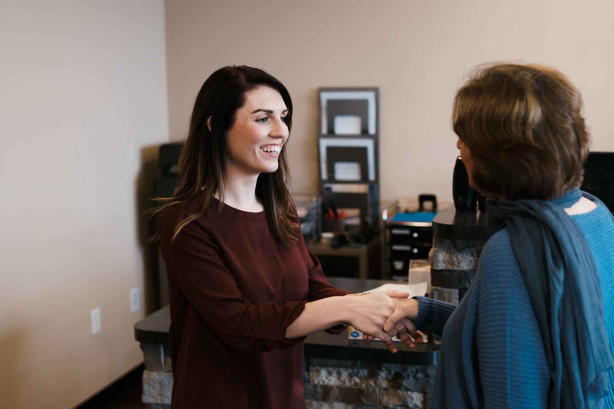 Arbor Vitae office management greets customer