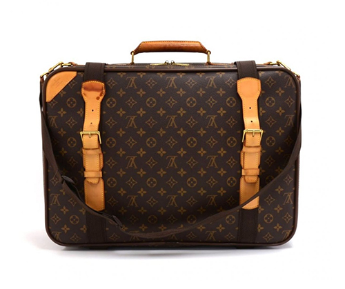 Suitcase by  Louis Vuitton