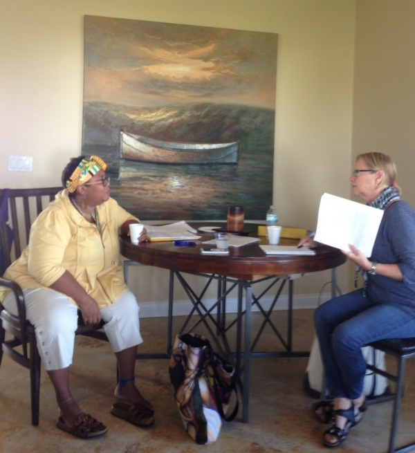 One of my favorite candid shots from the  writing conference  I host yearly. Here are writers Dahlma Llanos-Figueroa and Gale Massey discussing their manuscripts.