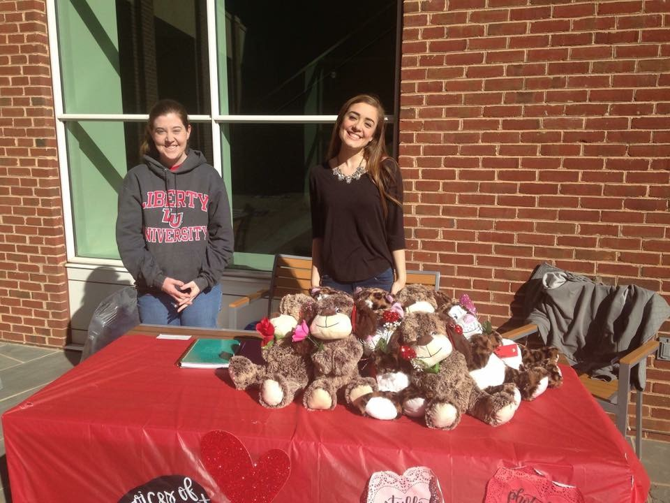 Valentine's Day Fundraier - Our lovely volunteers stood oustide the library at Liberty University to sell Valentine stuffed animals. It took about 5 hours the night before to cut, tie, and glue all the pieces together.