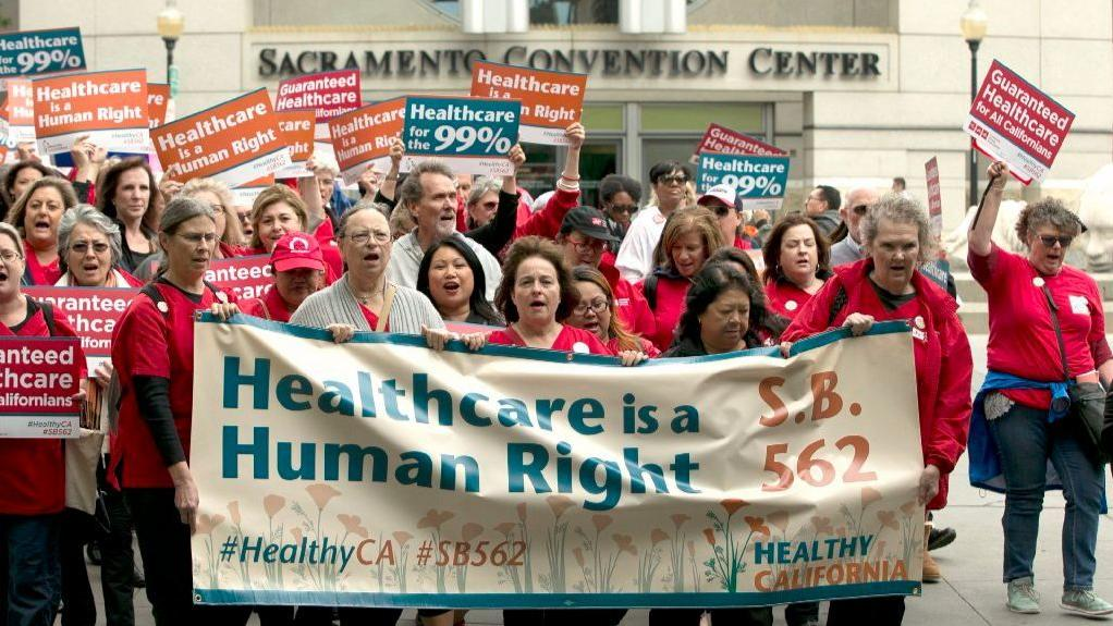 Supporters of single-payer health care march to the Capitol on April 26, 2017, in Sacramento. The bill, SB 562 by Democratic state Sens. Ricardo Lara, of Bell Gardens, and Toni Atkins, of San Diego, would guarantee health coverage for all California residents. (AP Photo)