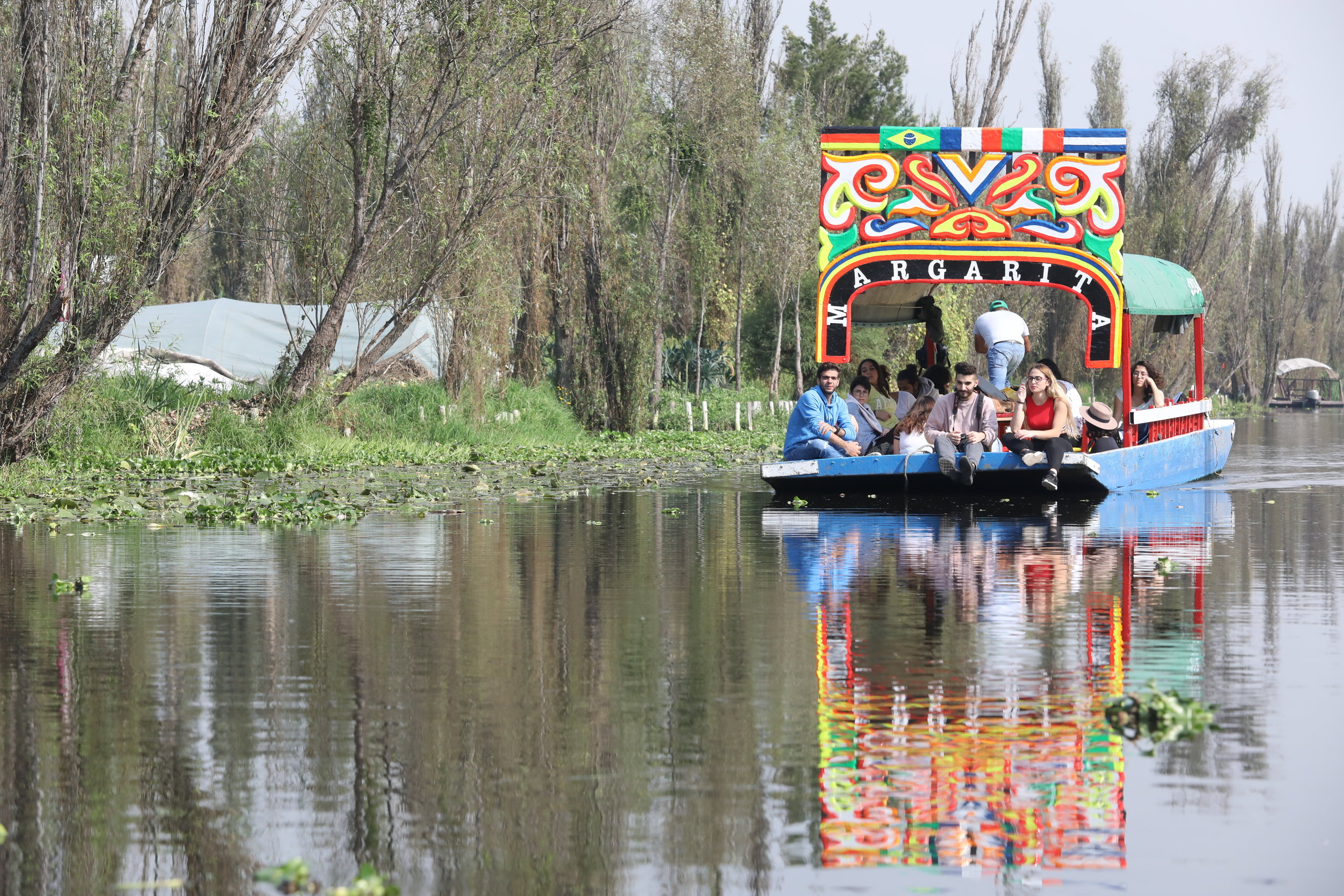 A trajinera boat floats along the Xocimilco canals / Photo by Krista Simmons