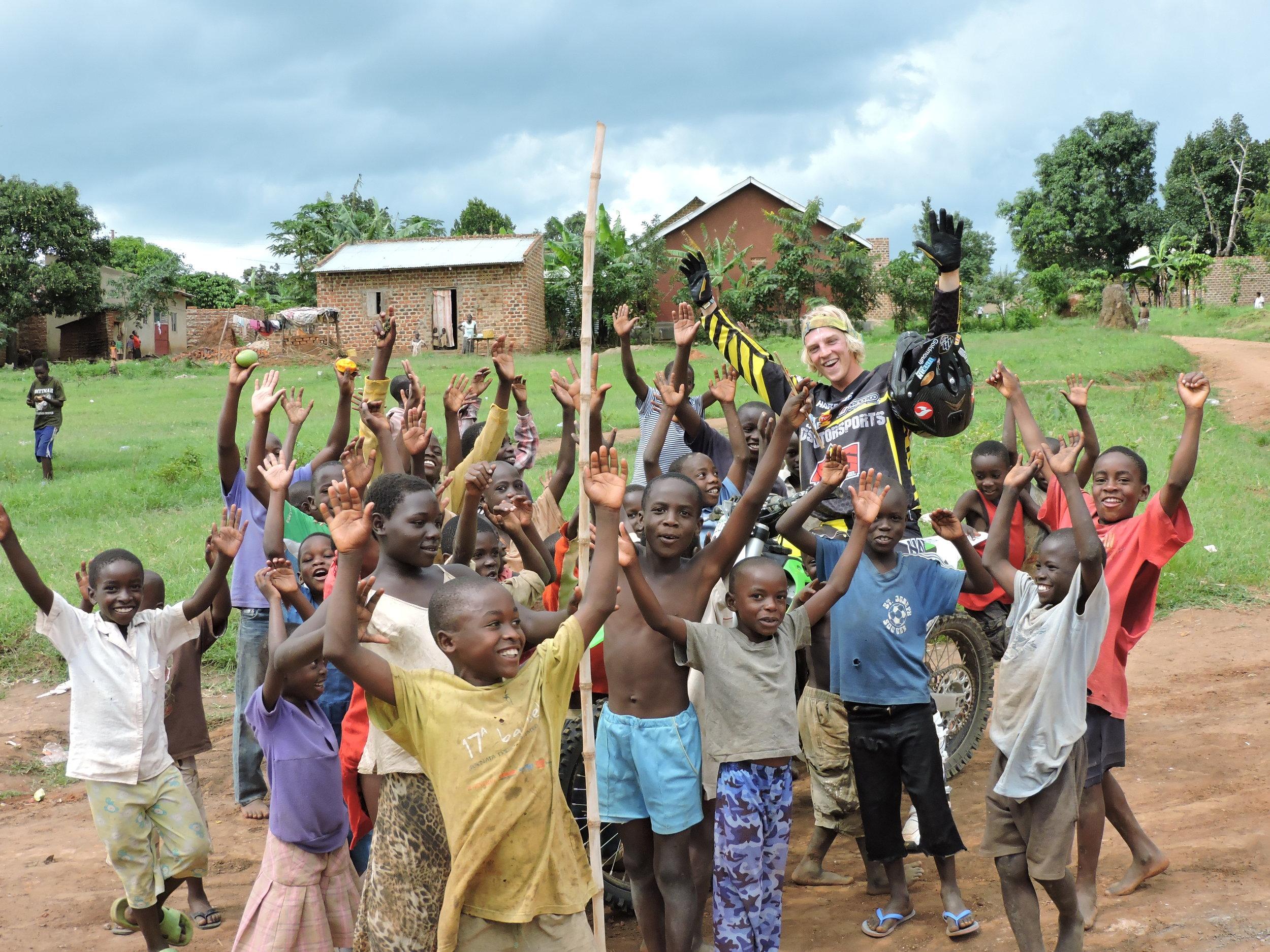 Daniel Sedlak making new friends while teaching Motocross and Enduro lessons in Uganda Africa