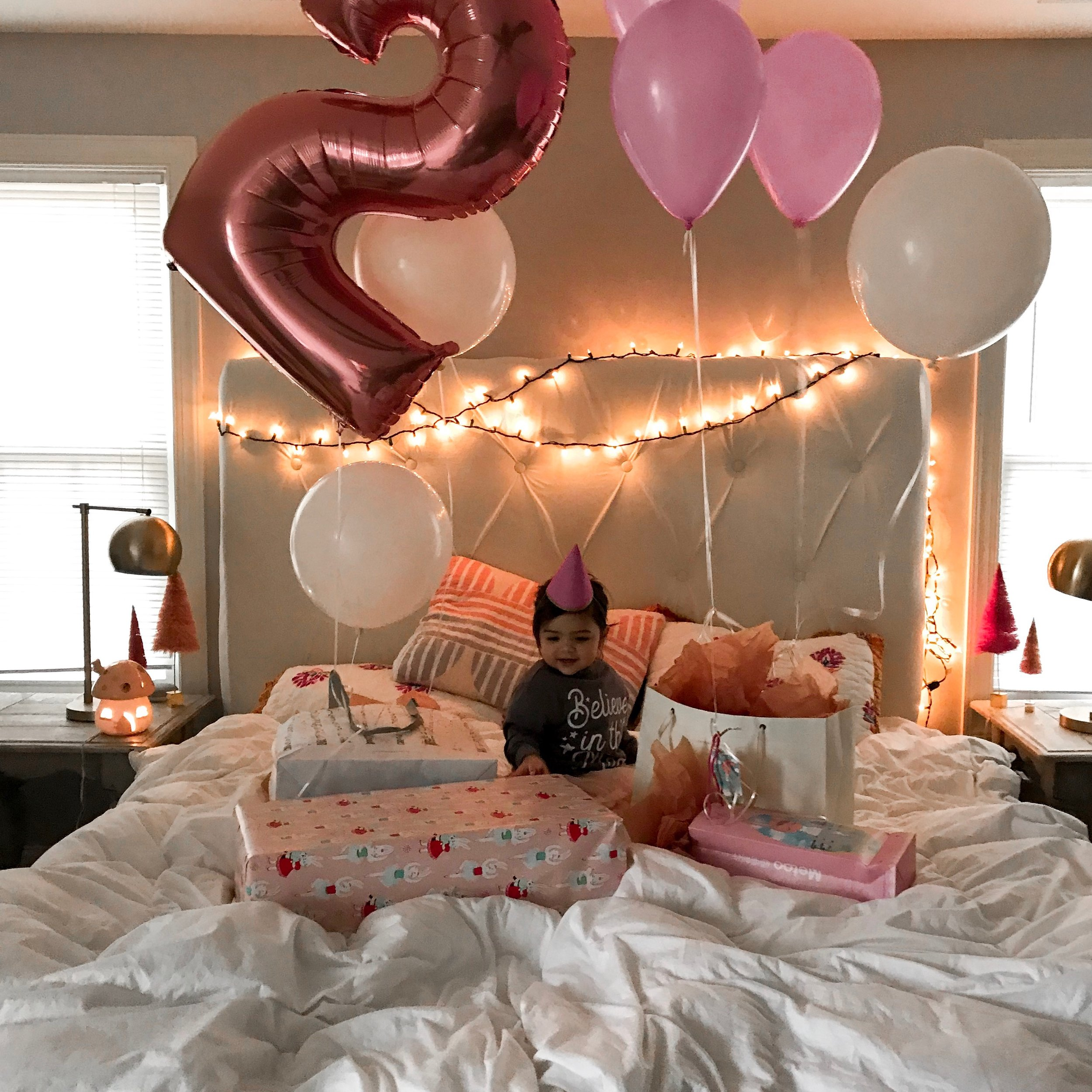 The sweetest magical moment from Hadley's second birthday celebration. Twinkle lights + balloons + magic.