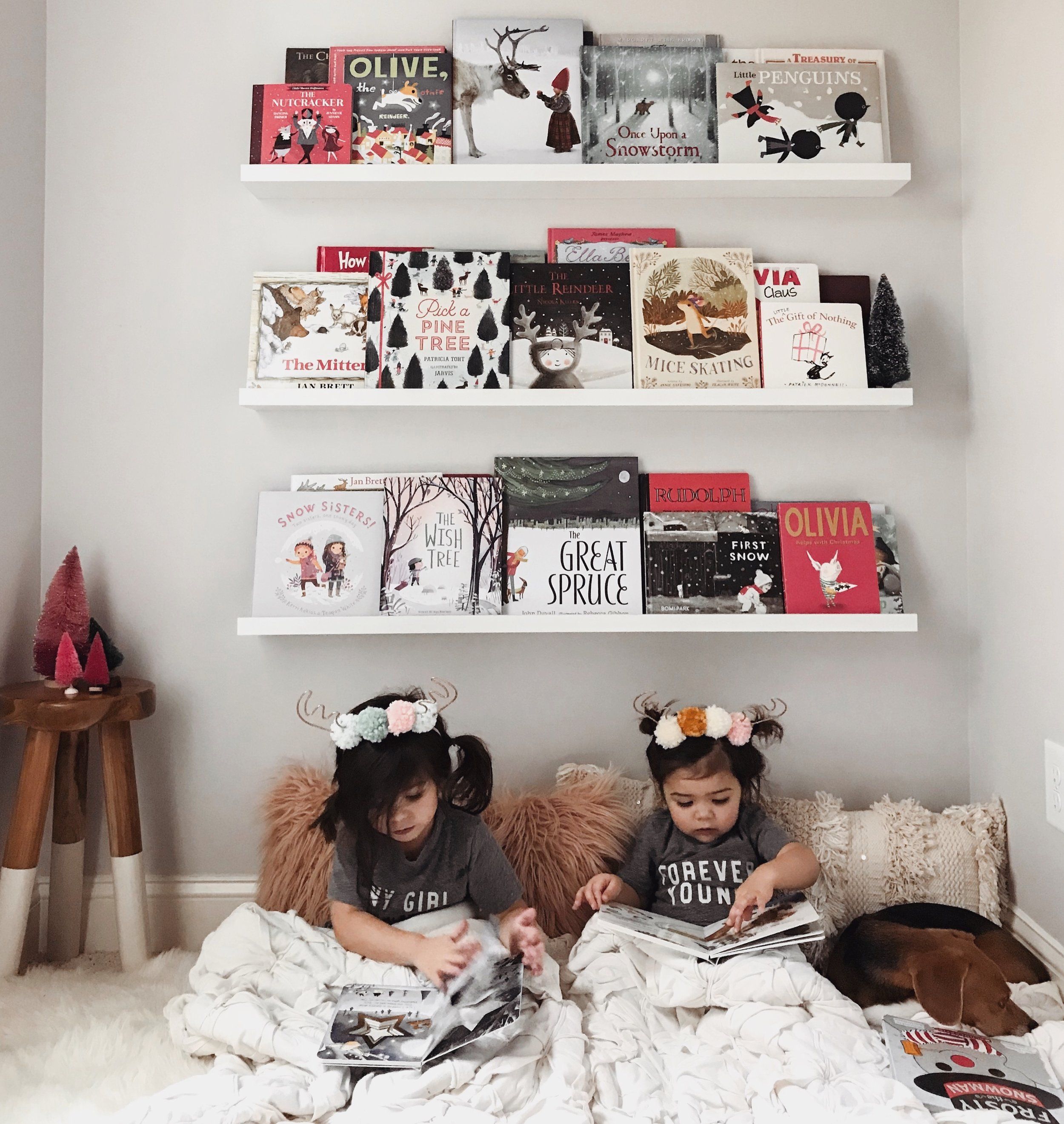 Another look at our holiday book wall and the girls are wearing the best little antler ears from  Indy and Pippa Co here!