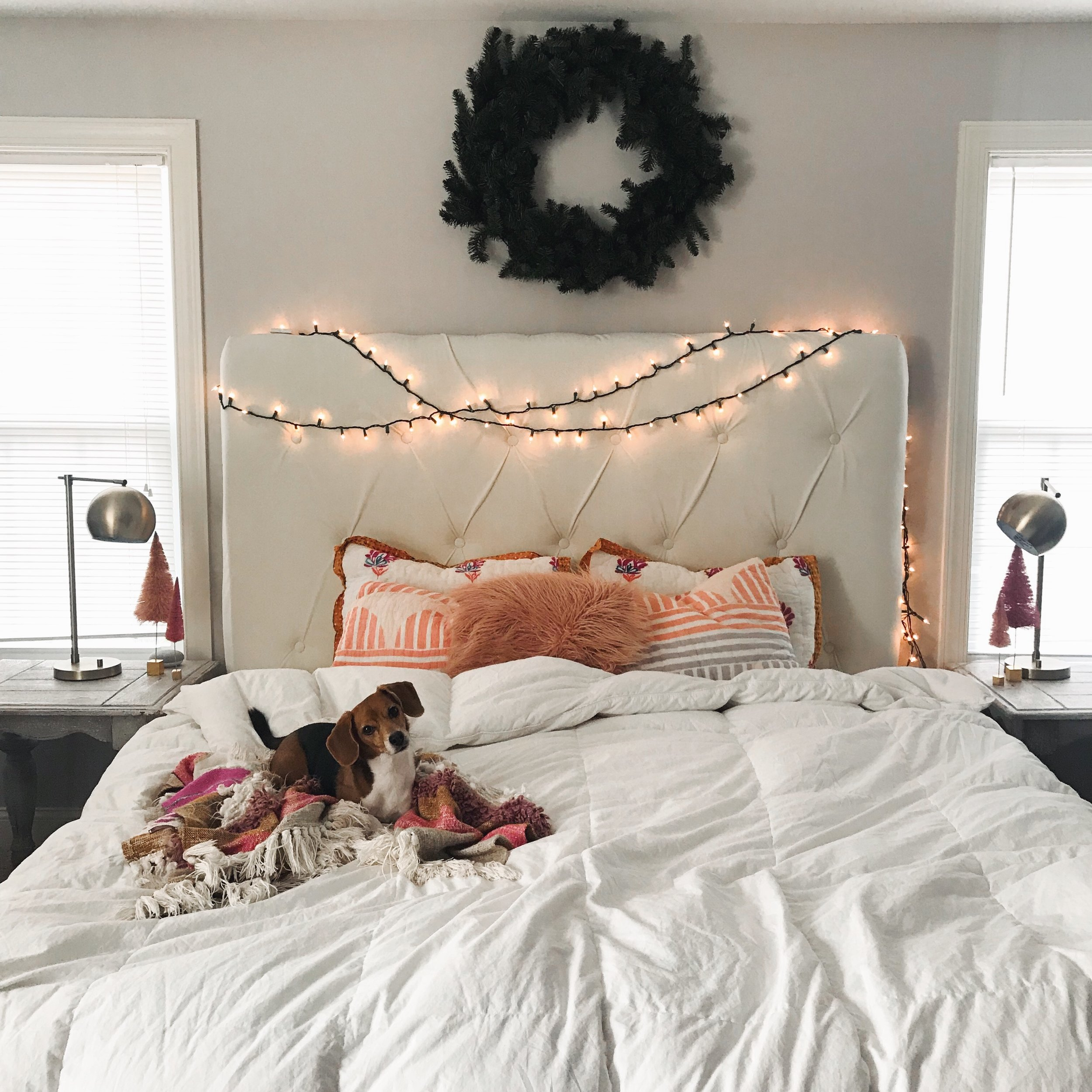 And there ya have it. A look around our home. This is our bedroom and just adding a simple wreath and twinkle lights completely transformed this area into my dreamland.  Night night!