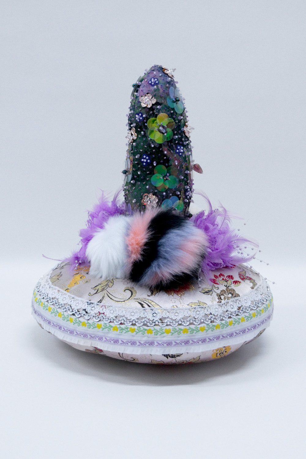 """Maintaining Appearances,  Crystal and plastic beads, sequins, found fabric, trim, fur keychains, polyester batting, thread, 16 x 16 x 15"""", 2018"""