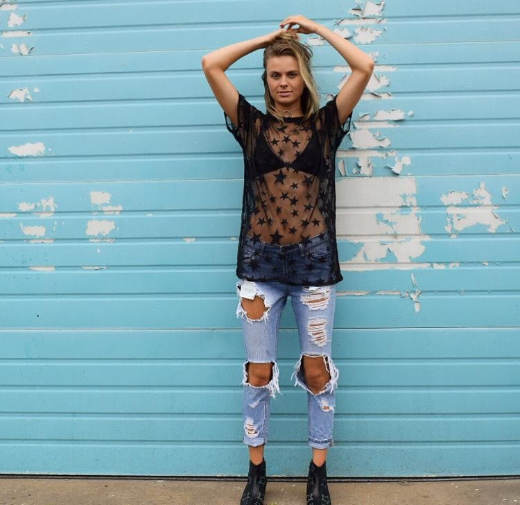 Mesh tops have become a millennial craze and are great if you're going for a more bold, edgy look. Pair a mesh top with distressed denim jeans or shorts to make the perfect look.  -Top:  Star Pattern Mesh Top  — Forever 21; $15.90  -Bottoms: Light Wash Distressed Jeans — DIY  -Shoes:  Y.R.U Reflective Star Boots  — Forever 21; $88.00  -Jewelry:  Clear Vinyl Ring Pendant Choker — Forever 21; $7.90
