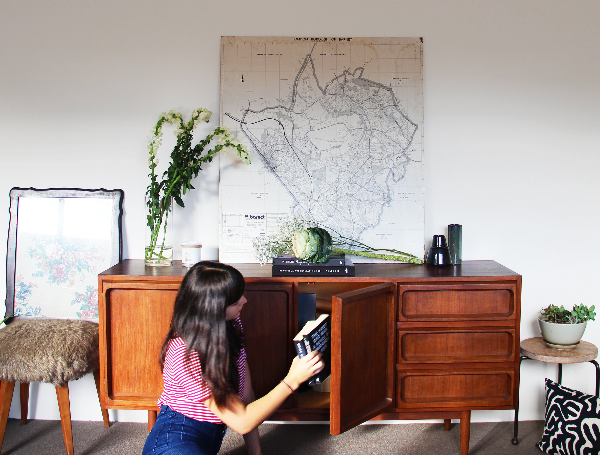 With a little bit of side table shuffling, the buffet fits perfectly along the notoriously empty wall.