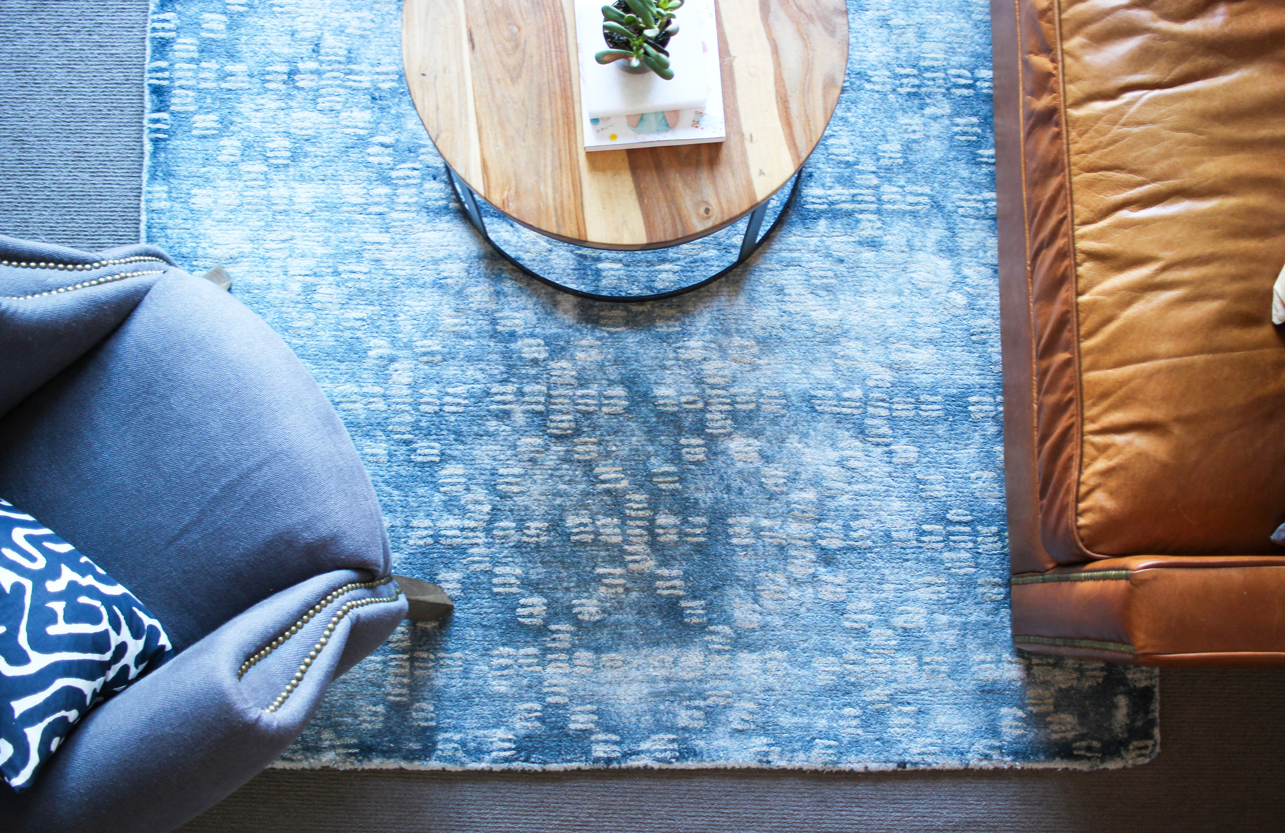YOUR RUG SHOULD PULL EVERYTHING TOGETHER BY TOUCHING EVERY PIECE OF FURNITURE