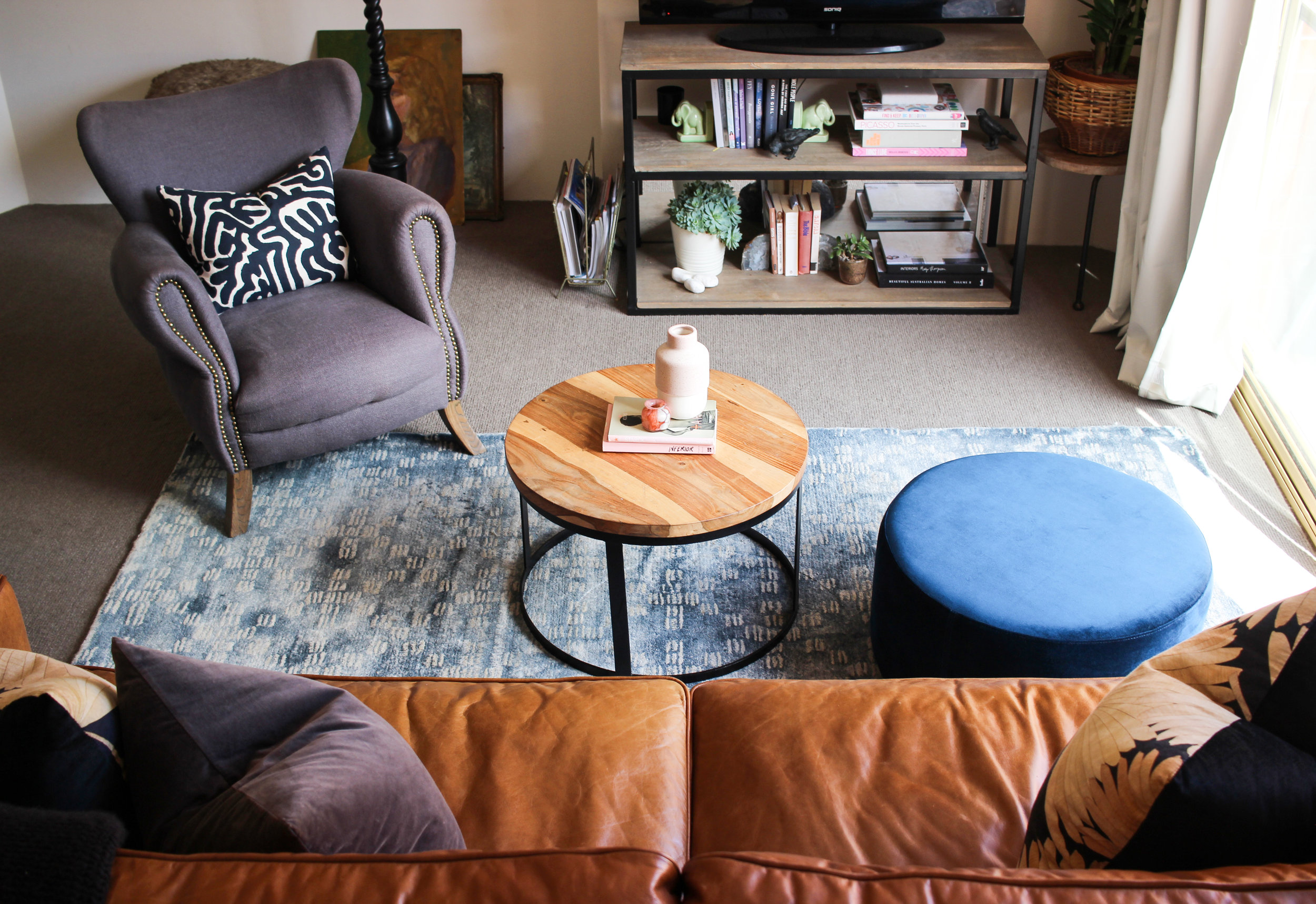 PULL YOUR FURNITURE IN TOGETHER TO MAKE EACH SPACE CLEARLY GROUPED.