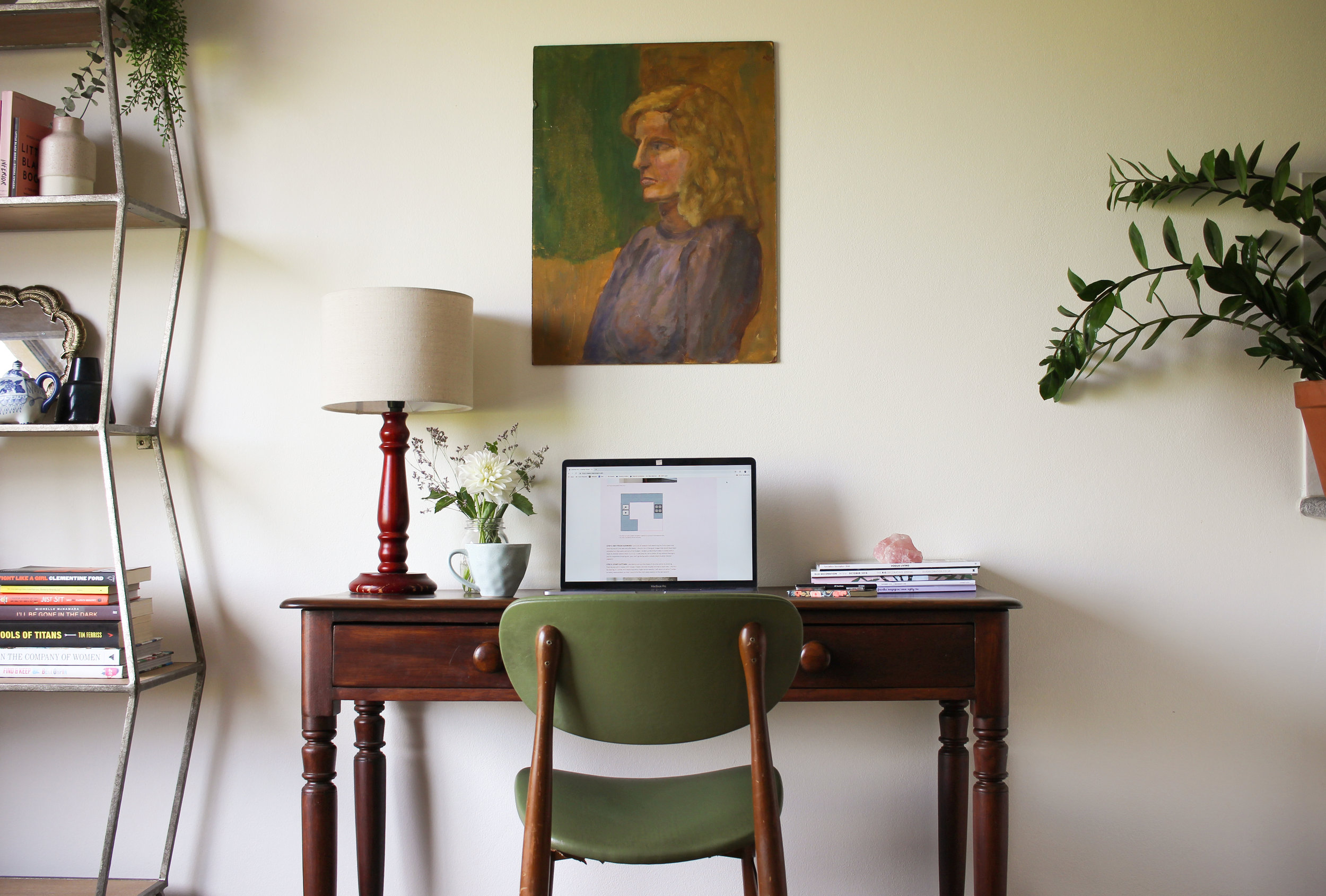 BEING STYLED WITH A LAMP, STACK OF MAGAZINES AND A CHAIR MAKES IT CLEAR THAT THIS IS A STUDY NOOK.