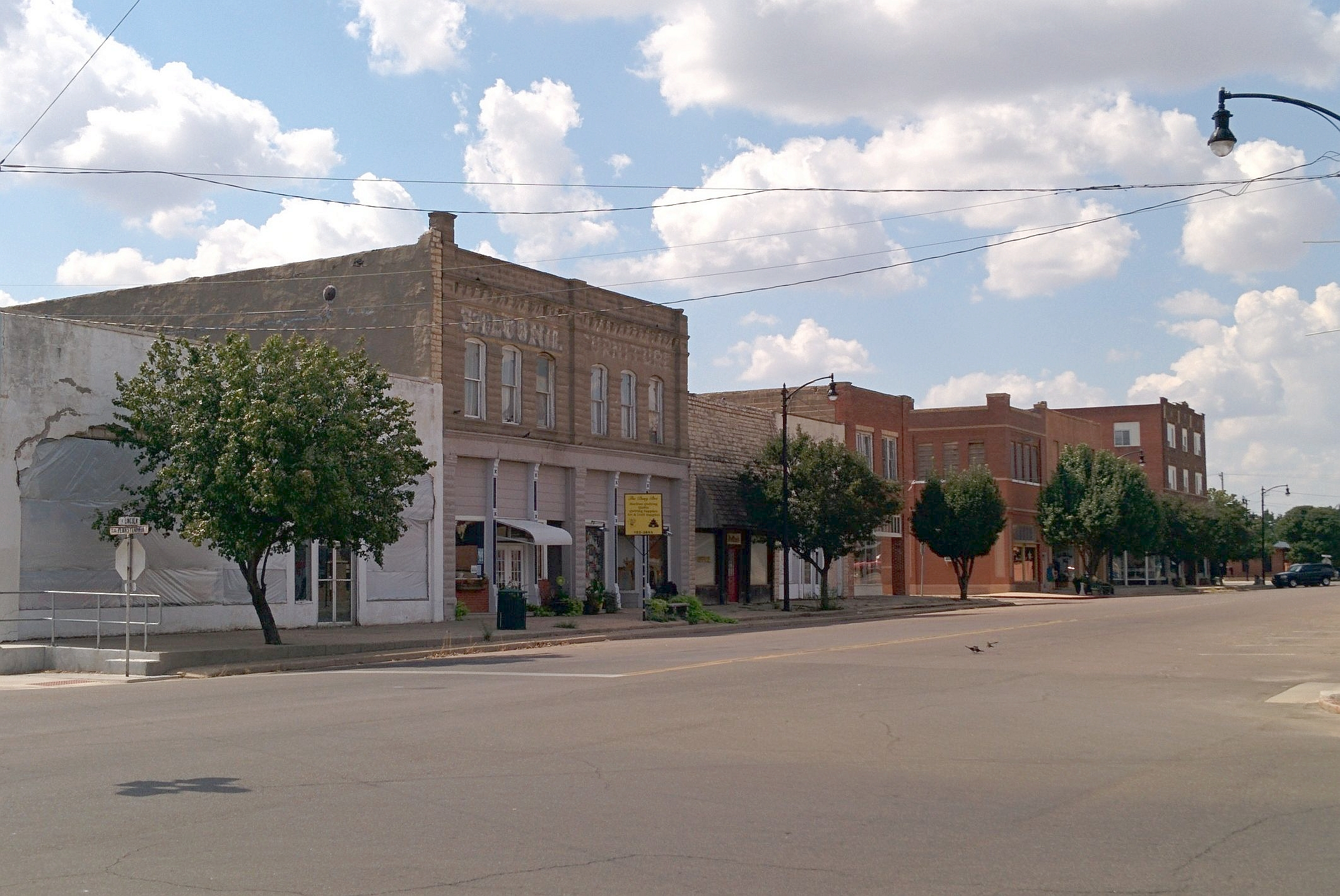 Downtown Magnum Historic District   By Crimsonedge34 - Own work, CC BY-SA 3.0, https://commons.wikimedia.org/w/index.php?curid=35741116