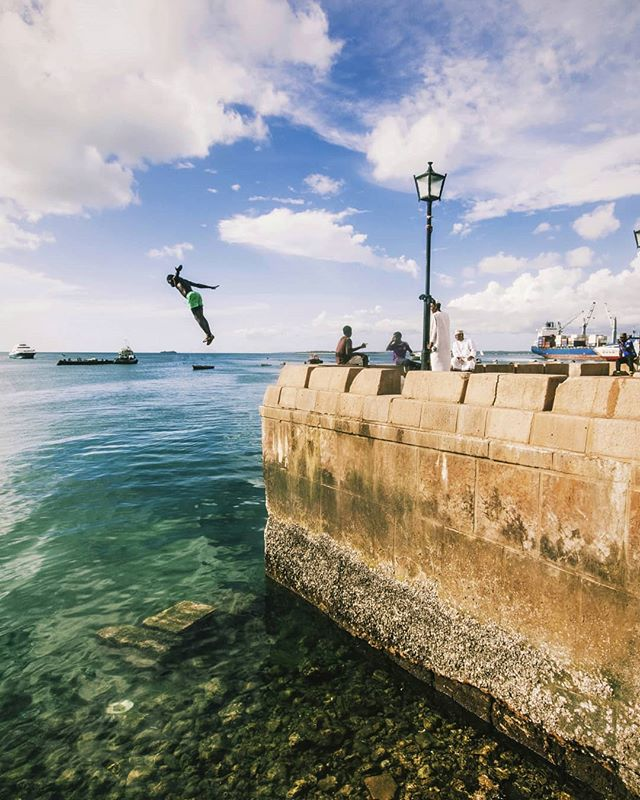 DAY 562 - Stone Town acrobatics! This place is so alive 🤸🏿‍♂️🤙 ————————————————————————— #Zanzibar | #Stonetown | #photooftheday | #Africa | #photography | #acrobatics | #beach | #island | #sunset | #canon | #overland | #roadtrip | #RTW | #travel | #Adventurerider | #neverstopexploring