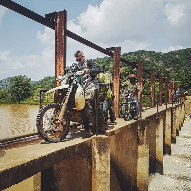 DAY 567 - What do you do when the main bridge is broken, and the only way across the river is a long narrow dam with a three meter drop on each side? Keep calm, remove all luggage, carefully maneuver the bike across, avoid shitting your pants and carry on 🤘 ————————————————————————— #Tanzania | #lushoto | #photooftheday | #Africa | #photography | #dam | #motorcycle | #BMW | #G650xChallenge | #canon | #overland | #roadtrip | #RTW | #travel | #Adventurerider | #neverstopexploring