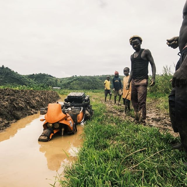 DAY 585 - It's not always easy to keep the bike on the trail! Peter really got his 640 down deep in the water. Luckily five strong men who didn't mind getting a little wet and dirty came to Peters rescue. They were beyond excited afterwards when he gave them some small money for their efforts!  #Rwanda | #Africa | #photooftheday | #interfotonorge | #KTM | #640ADVENTURE | #mountains | #trail | #motorcycle | #mud | #canon | #overland | #roadtrip | #RTW | #travel | #Adventurerider | #neverstopexploring