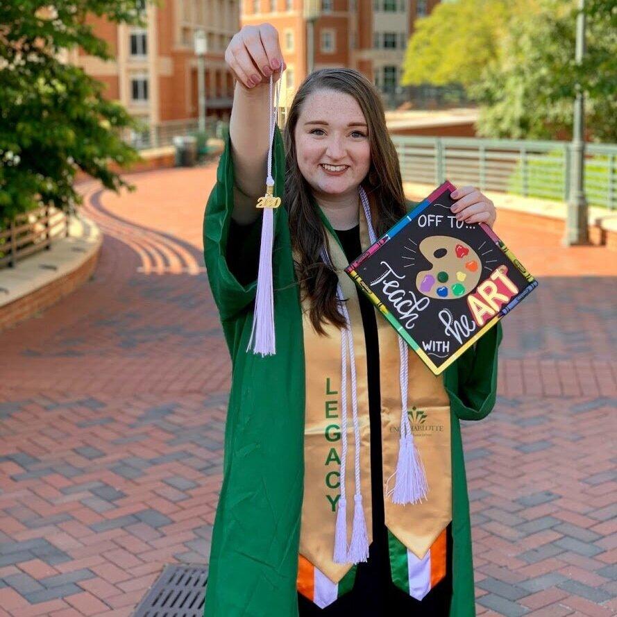 student holding her grad cap