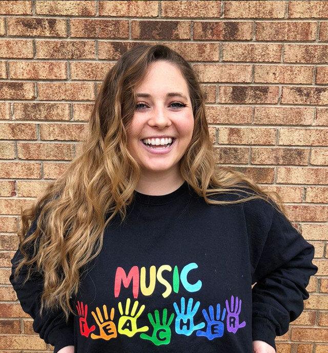 student with a music teacher shirt on
