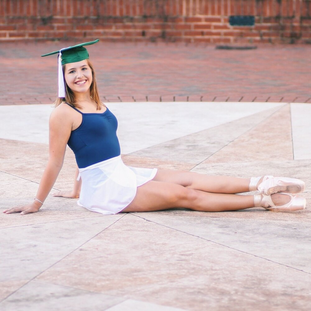 dancer in point shoes and graduation cap