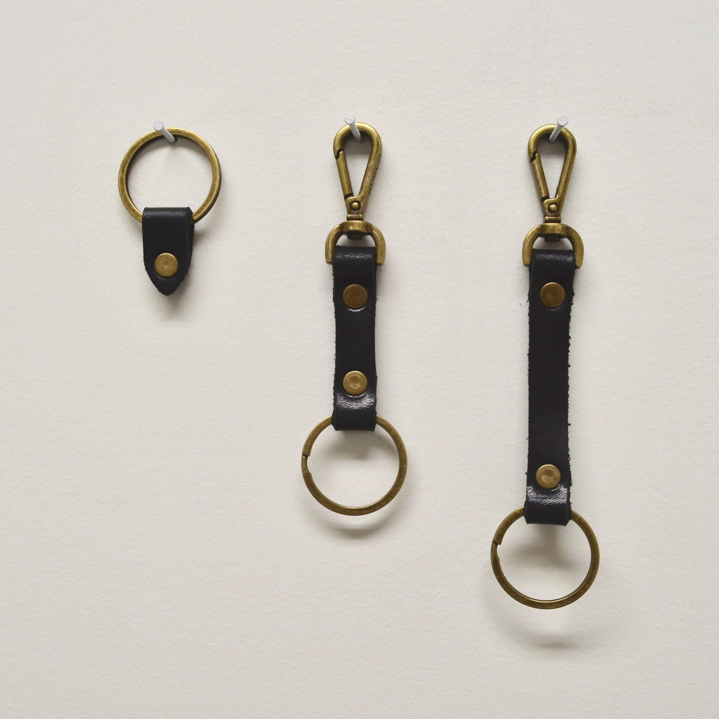 "- LEATHER TAB KEYRING IN BLACK, 5"" LEATHER CLIP KEYRING IN BLACK & 61/4"" CLIP KEYRING IN BLACK"