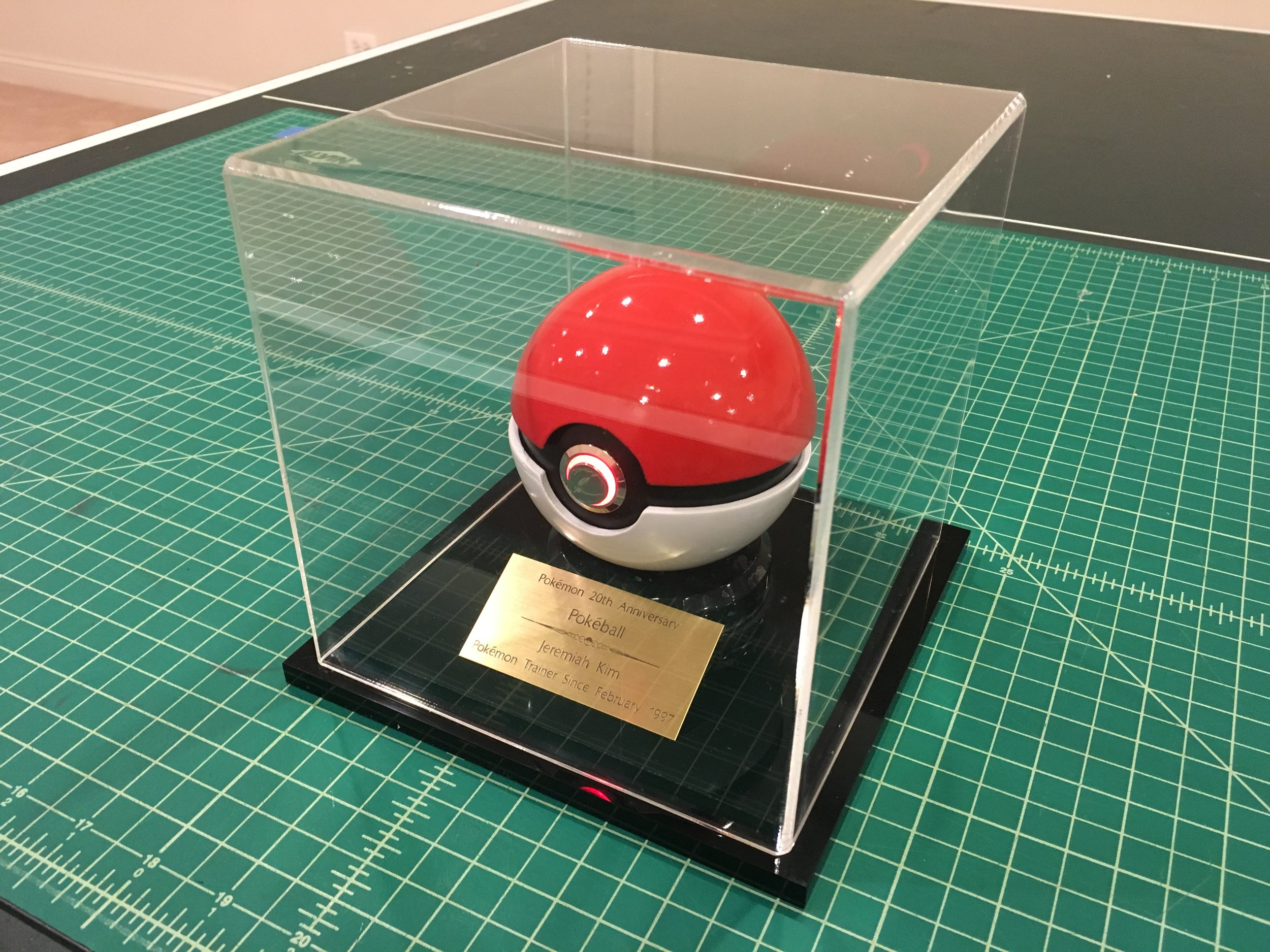 A custom acrylic display case with a plaque was created to display the pokéball in a place of honor.