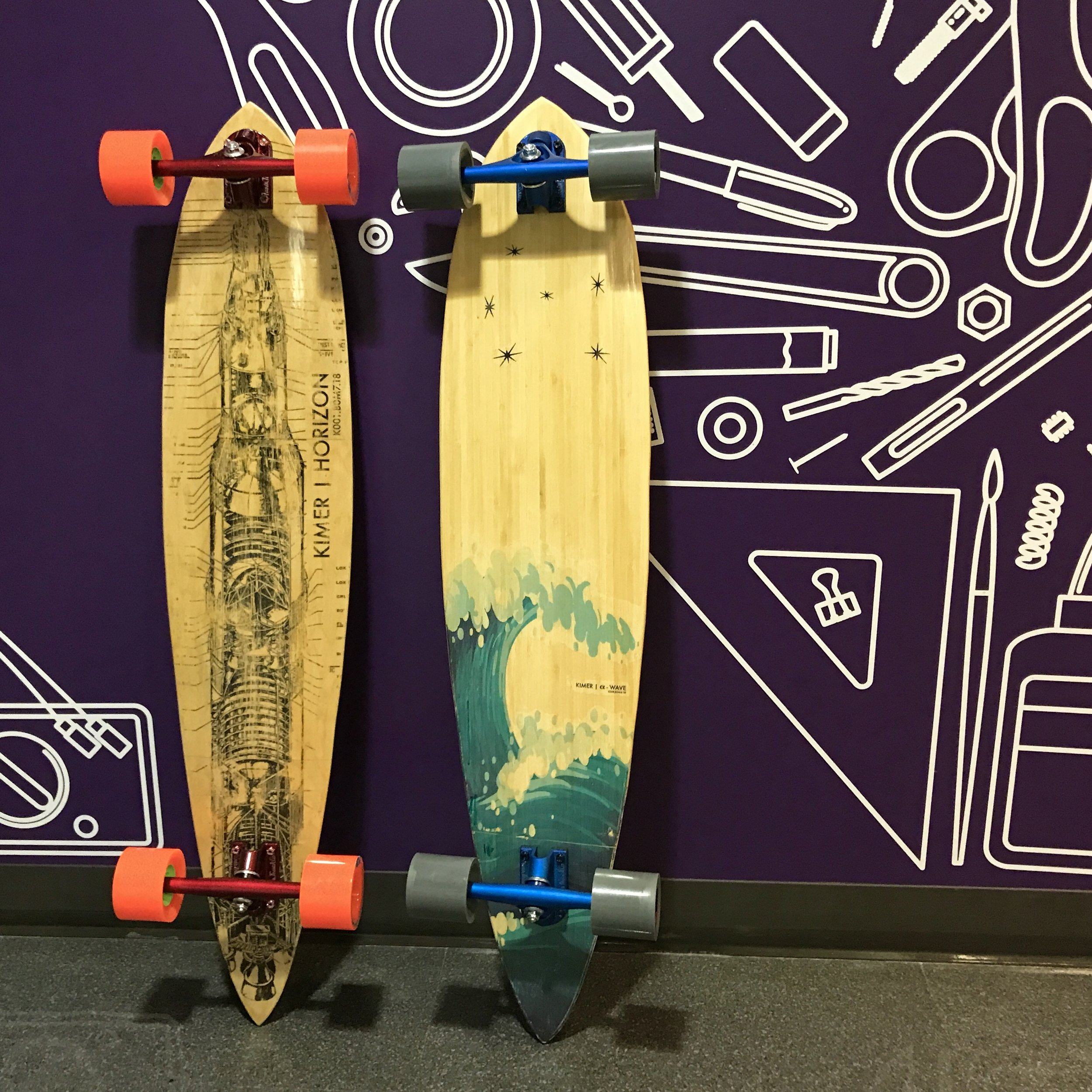 The Kimer Horizon and α-Wave, 41 inch pintail boards featuring custom graphics.