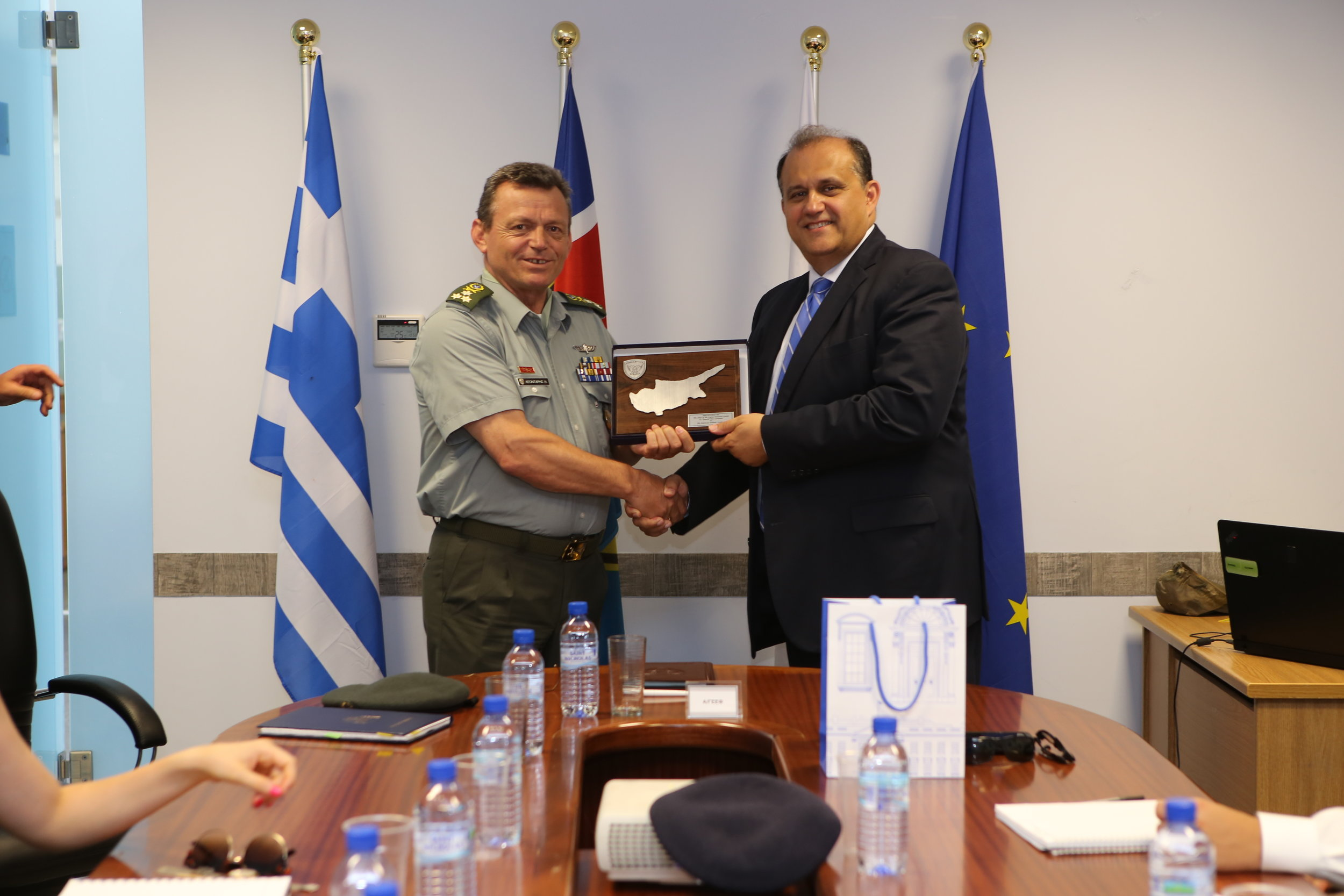 Lt. Gen. Elias Leontaris, Chief of the Cypriot National Guard General Staff exchanges gifts with Nick Larigakis.