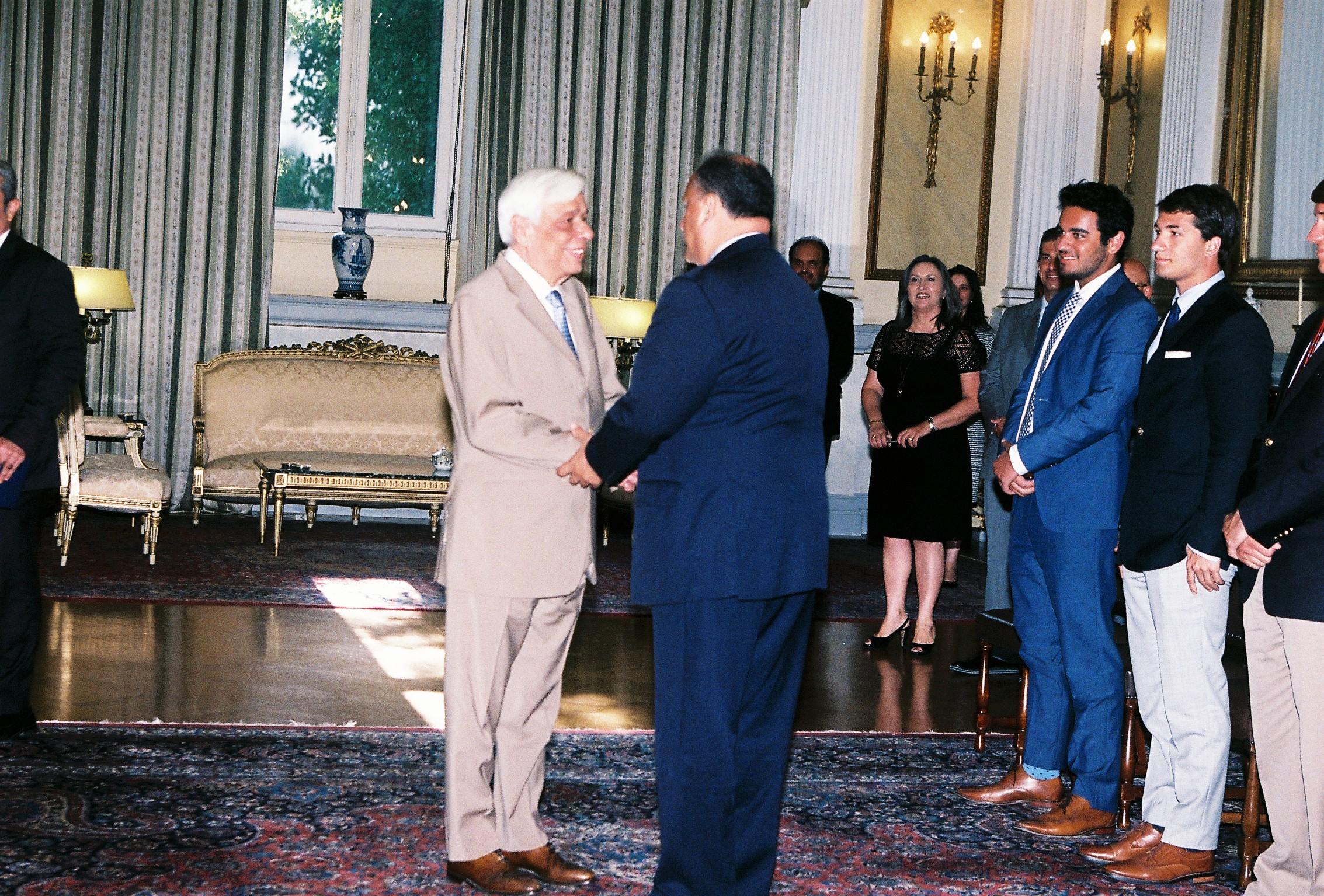 President Prokopis Pavlopoulos welcoming Nick Larigakis and the students.