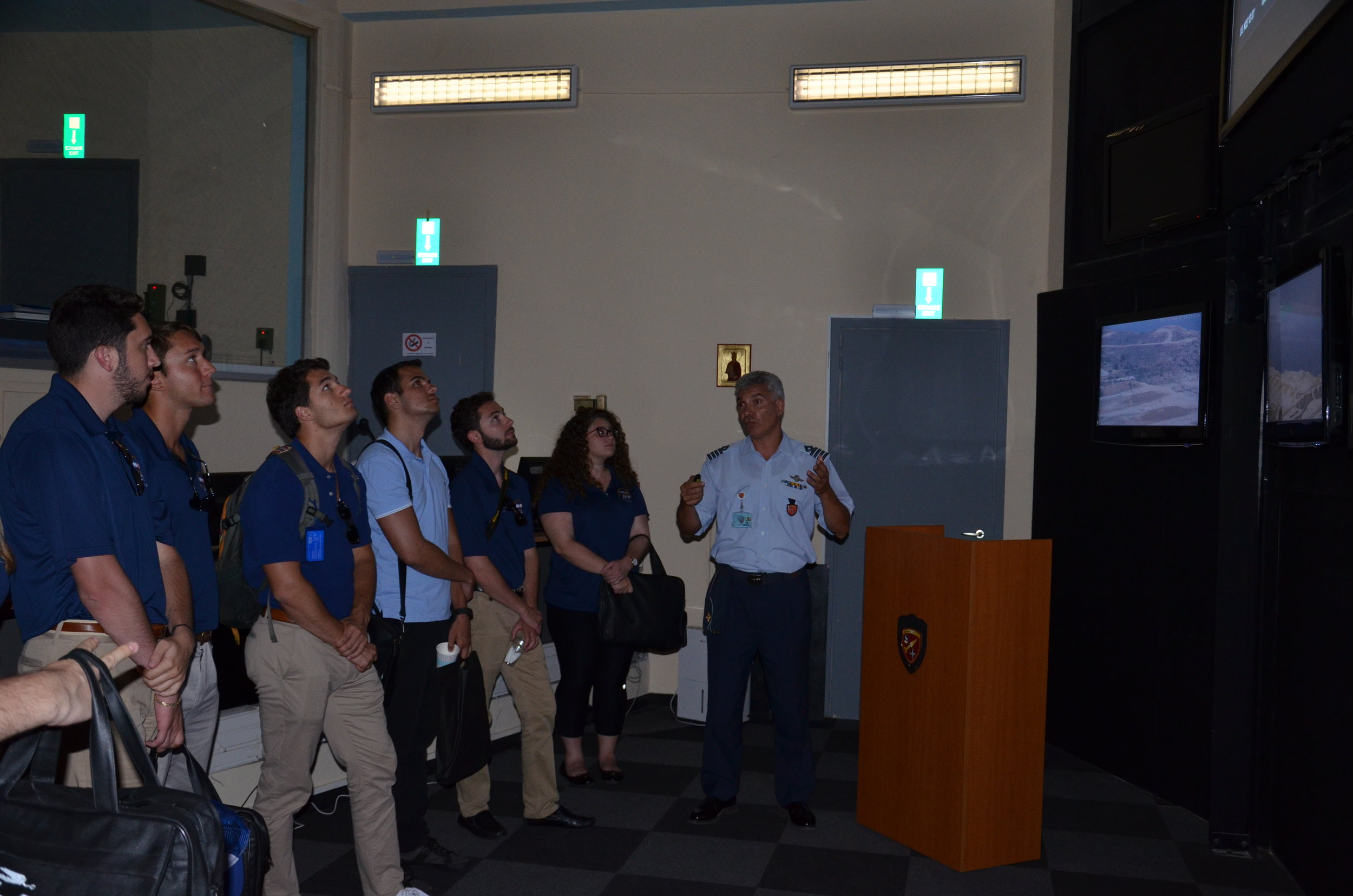 Students receive a briefing on military readiness and response in a live NAMFI control room.