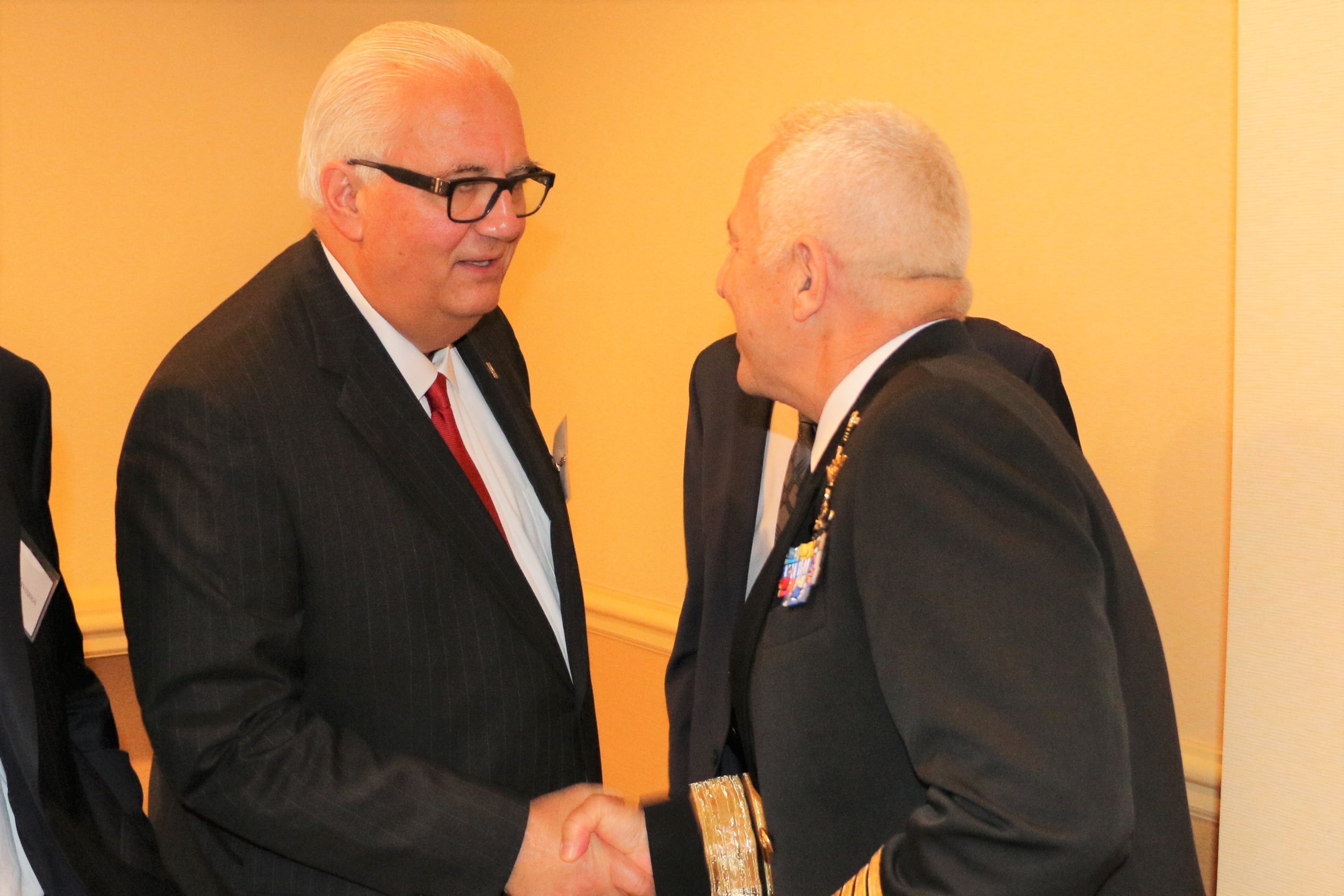 Former Acting Assistant Secretary of the Army for Acquisitions, Logistics, & Technology Dean Popps greeting Admiral Apostolakis.