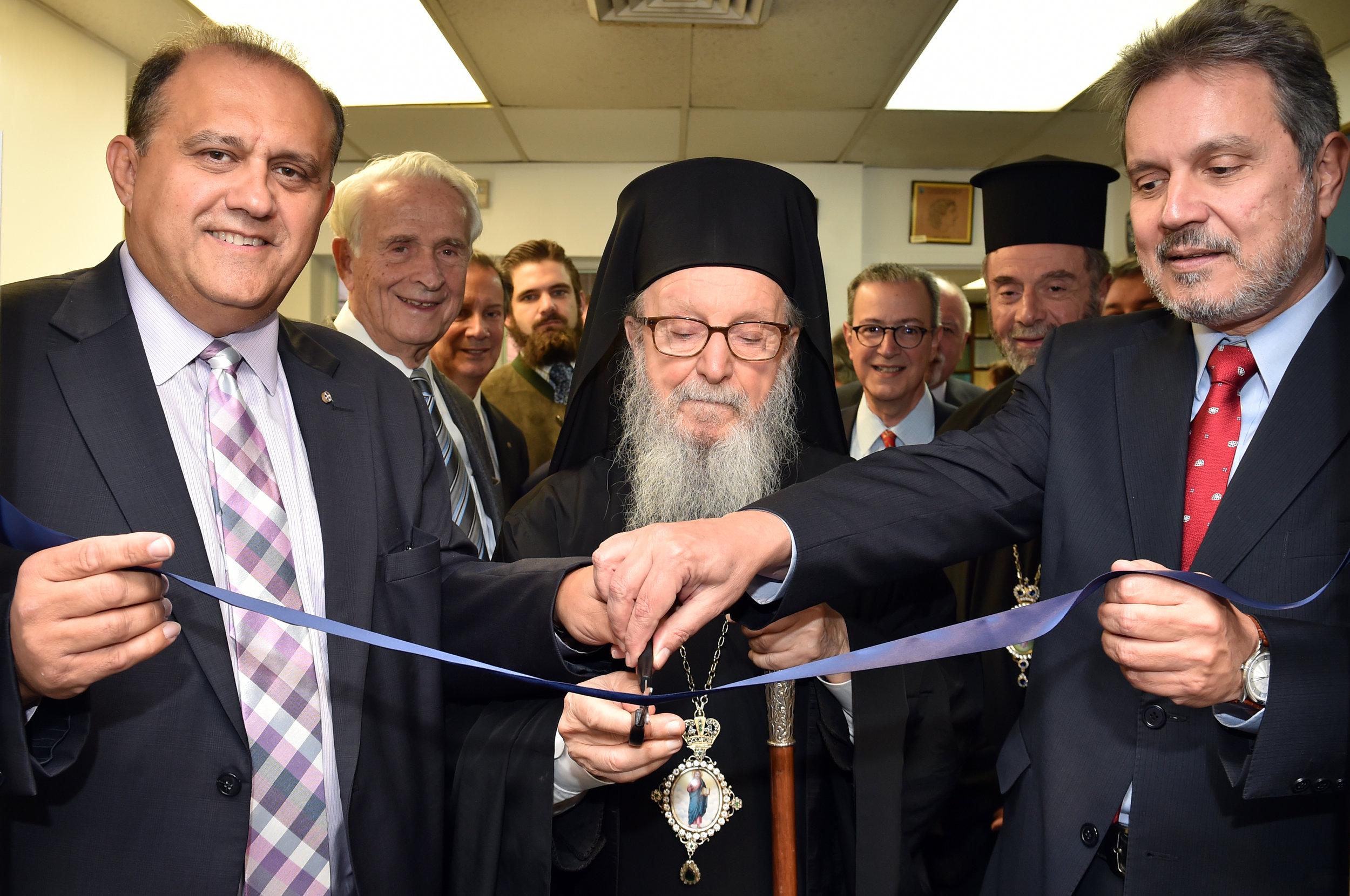His Eminence, Nick Larigakis, and Ambassador Haris Lalacos of Greece cut the ceremonial ribbon.
