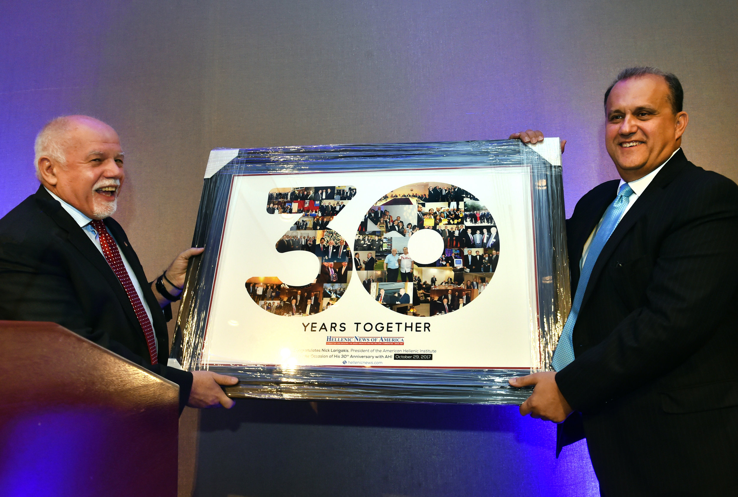Paul Kotrotsios presents Nick Larigakis with a gift to remember thirty years.