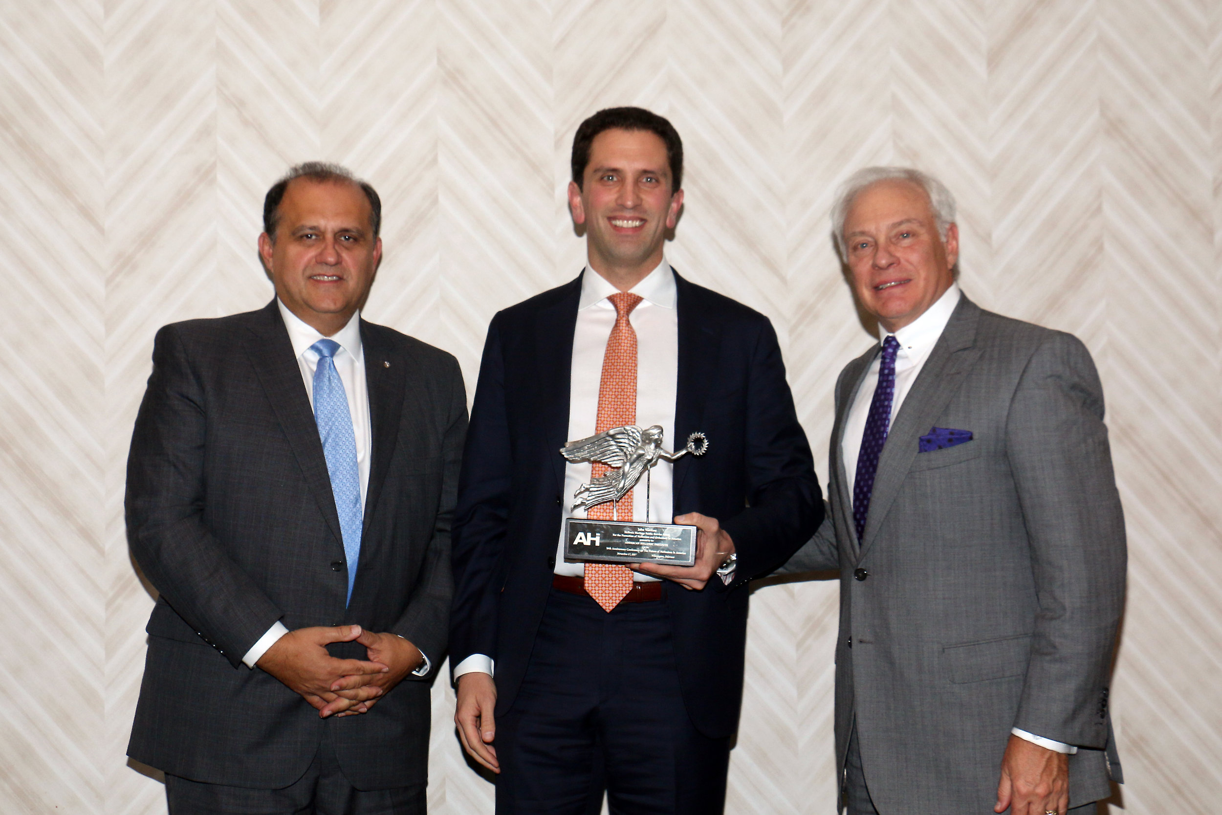 Nick Larigakis and Nick Chimicles present John Vasiliou with the AHI Hellenic Heritage Public Service Award for the Promotion of Hellenism and Orthodoxy in America.