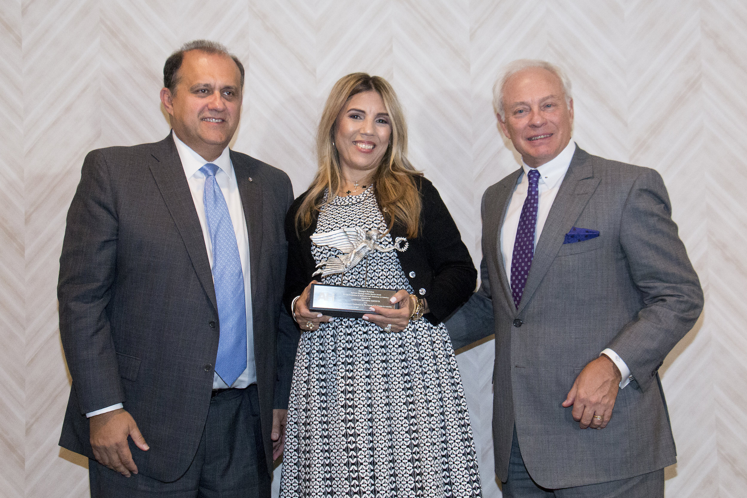 Nick Larigakis, President of AHI and Nick Chimicles, Conference Chairman present Georgia Halakos with the AHI Hellenic Heritage Public Service Award for the Promotion of Hellenism and Orthodoxy in America.