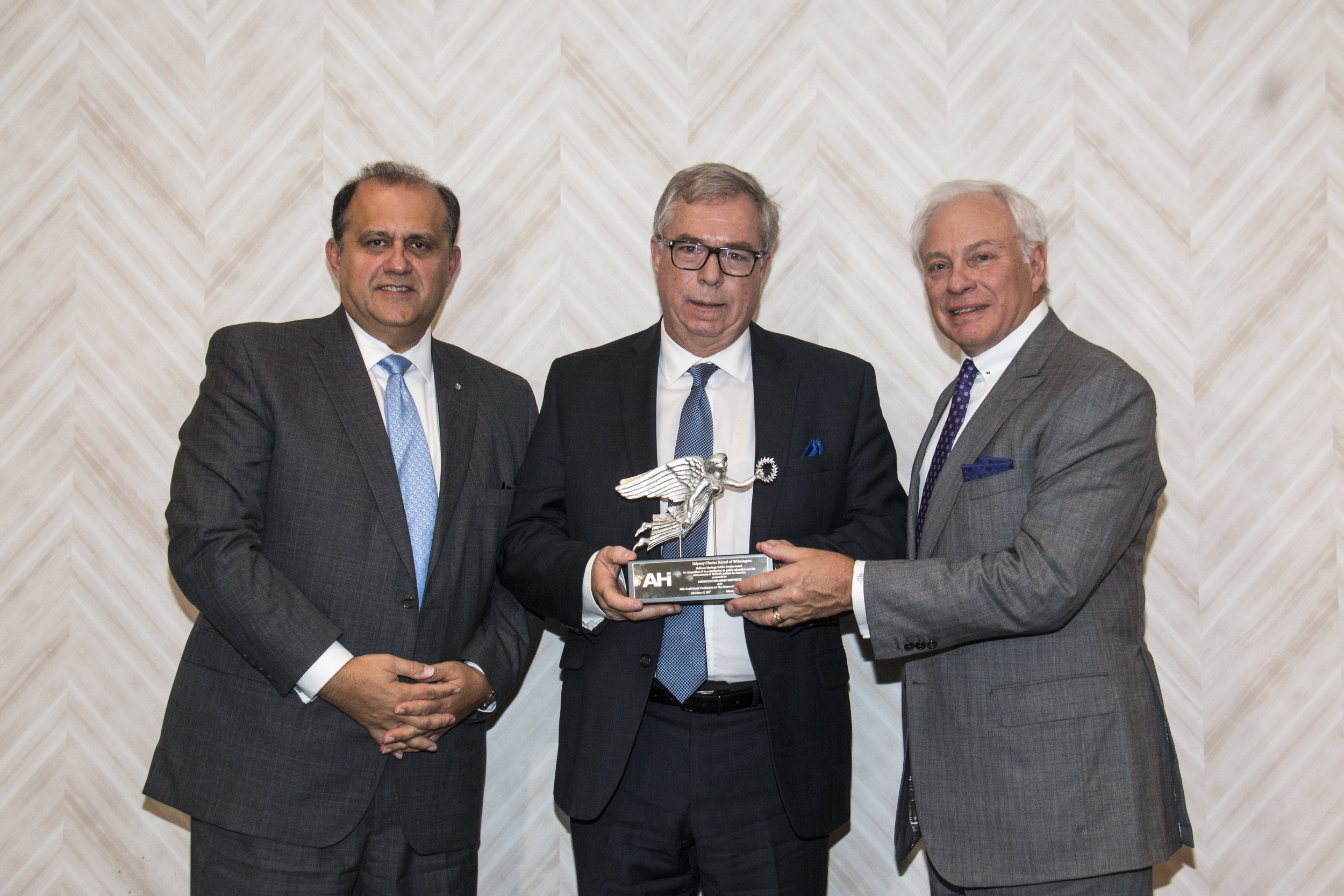 Dimitri Dandolos, President of the Board of Directors, accepts the AHI Hellenic Heritage Public Service Award in recognition of its contribution to public education and the advancement of Hellenic paideia in America on behalf of the Odyssey Charter School of Wilmington from Nick Larigakis and Nick Chimicles.