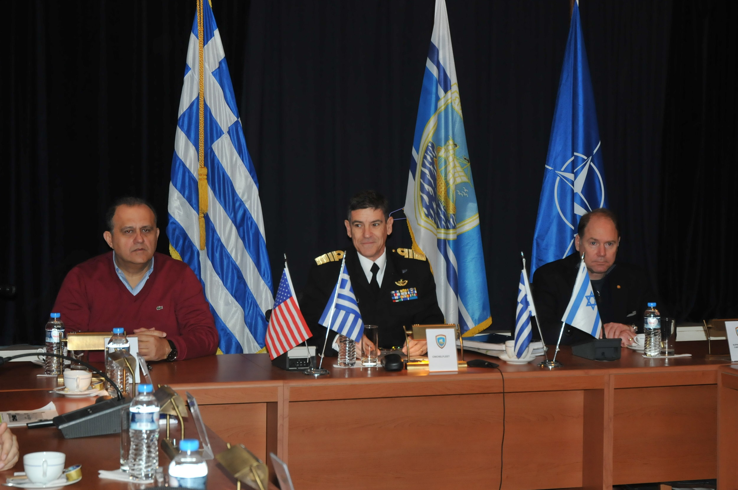 (L-R) Nick Larigakis; Vice Admiral Ioannis Pvalopoulos, Commander in Chief of the Greek Naval Fleet; Carl R. Hollister at Salamis Naval Base recieving a Naval Defense briefing.
