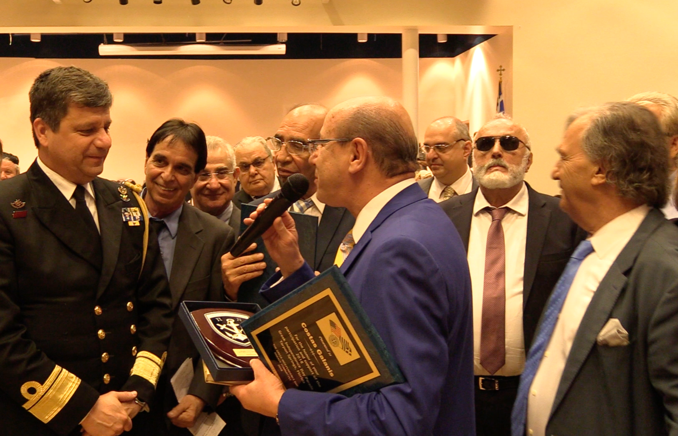 Read Admiral Ioannis Paxivanakis presents AHI Foundation President Constantine Galanis with an honorary plaque.