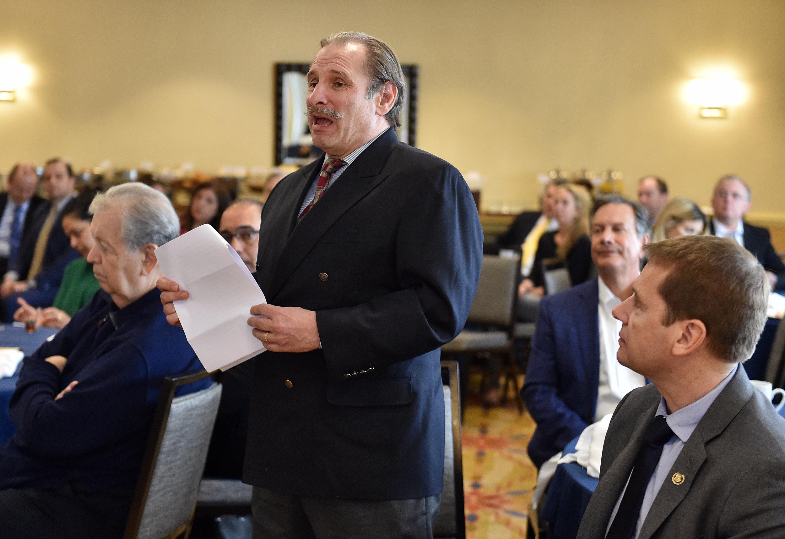 AHI Legal Counsel, Nick Karambelas, asks the panelists a question.