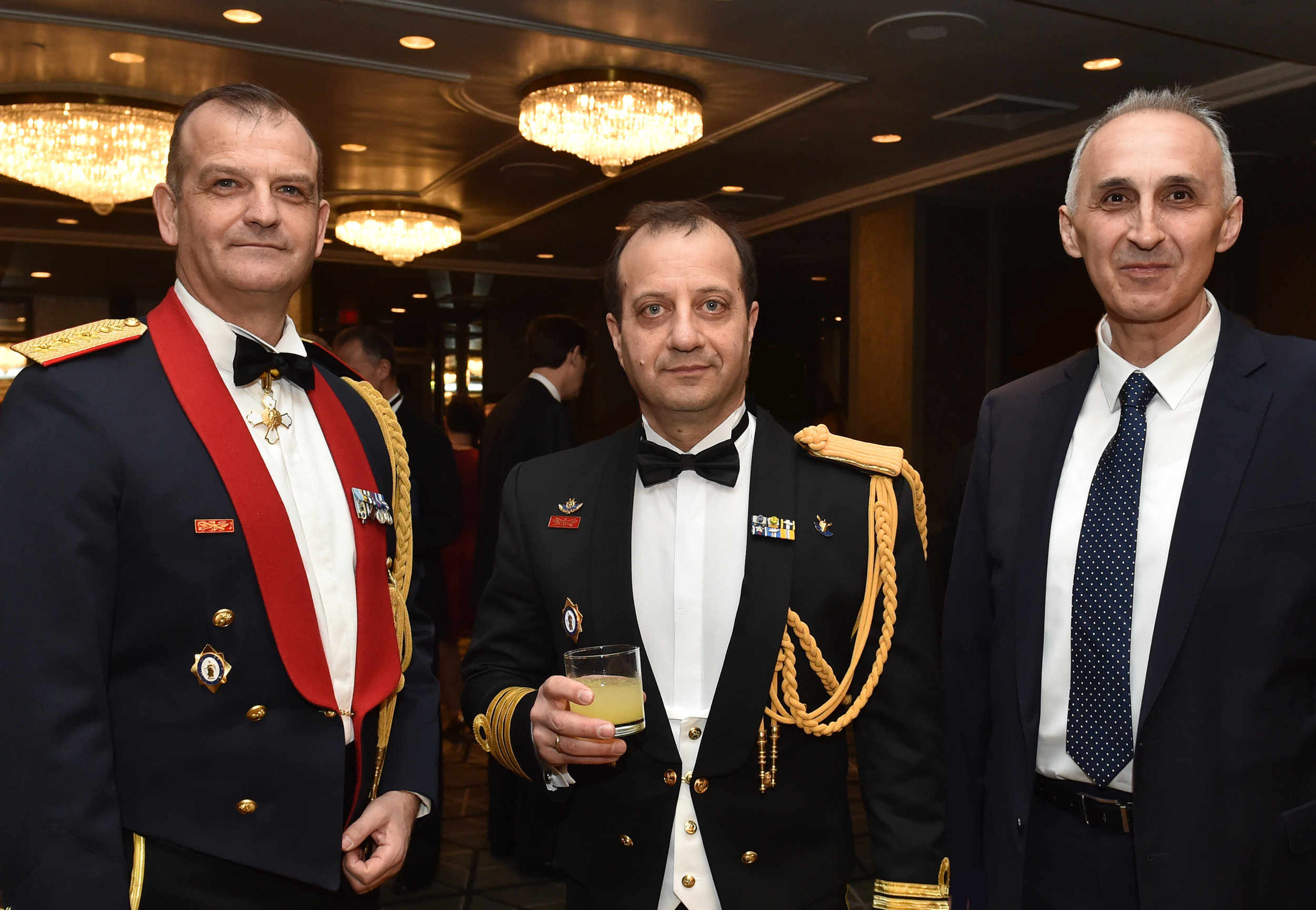 (L-R) Colonel Panagiotis Kavidopoulos, Defense Attache, Greek Embassy to the U.S.; Captain Charalampos Pegklidis, Naval Attache, Greek Embassy to the U.S.; and unidentified guest.