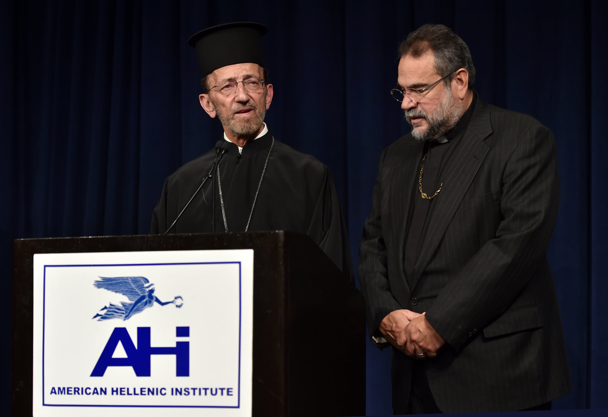 His Eminence Metropolitan Gerasimos of San Francisco (left) is assisted by Rev. Konstantinos Pavlakos in offering the invocation.