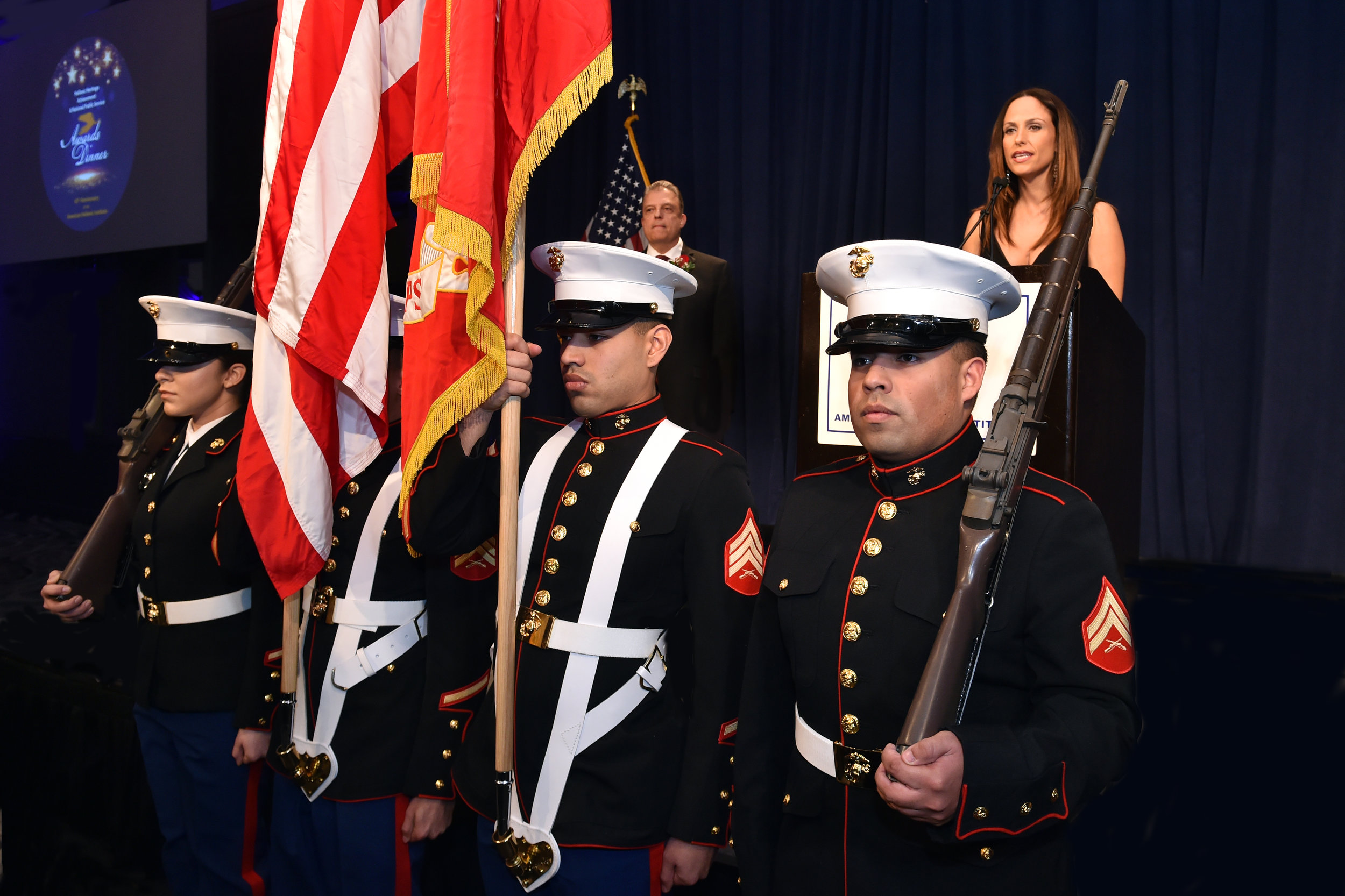 The Marines of Headquarters Battalions present the colors.