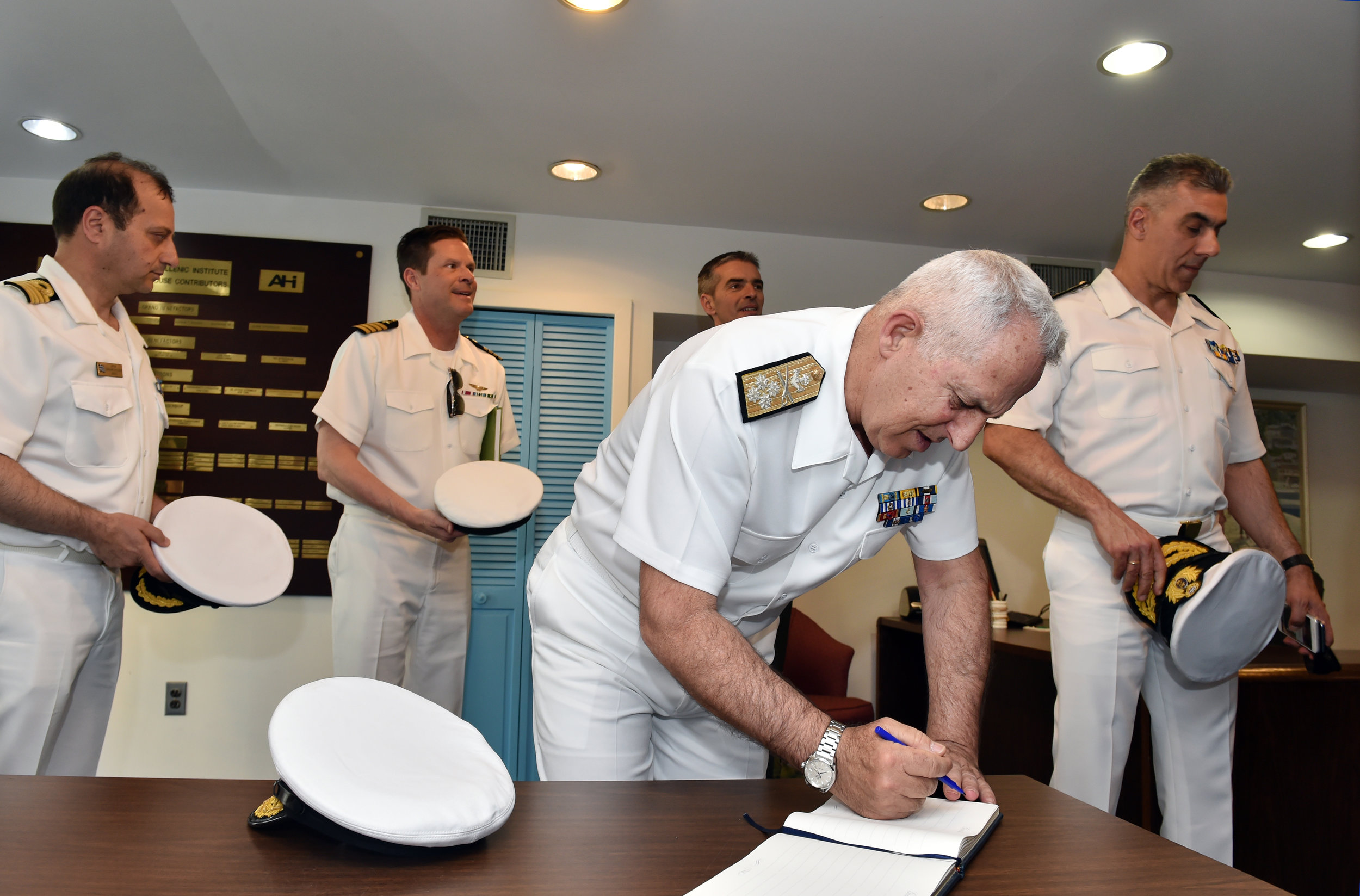 Admiral Apostolakis signing the official guest book.