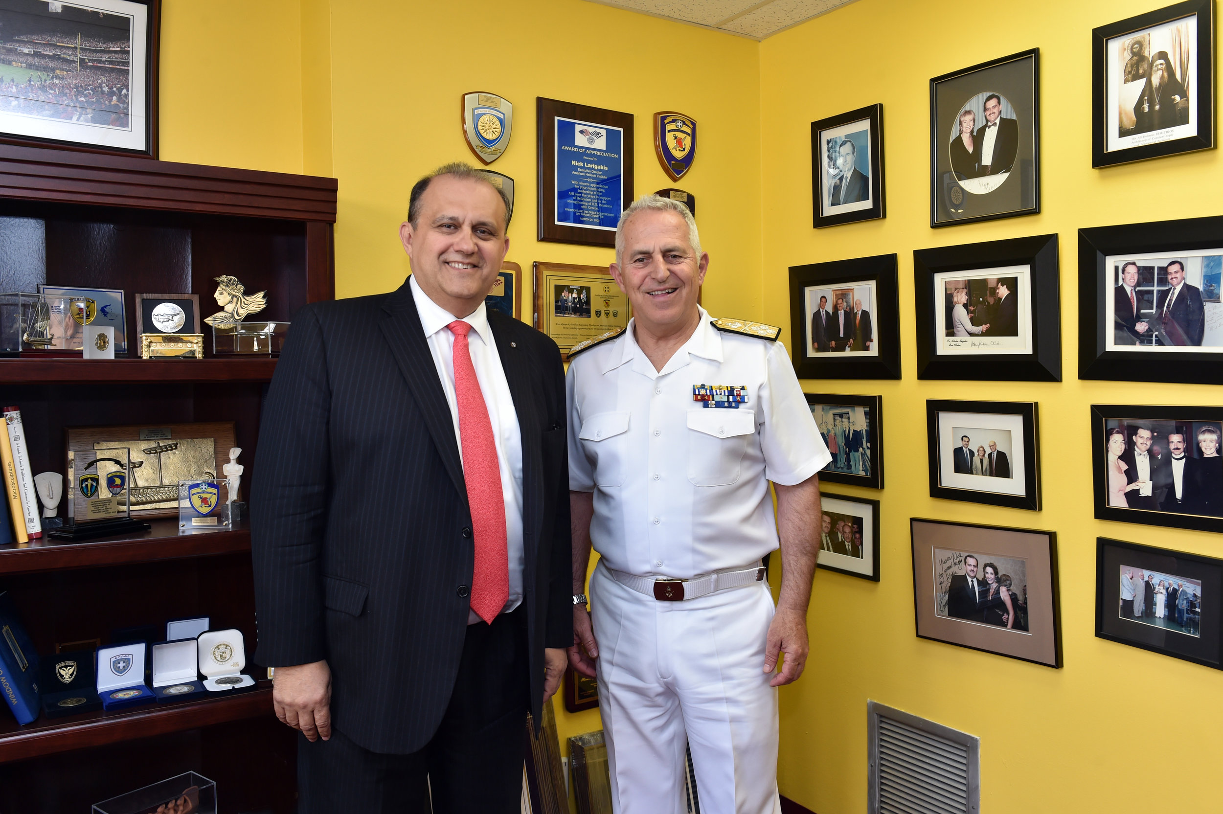 Admiral Apostolakis visiting with Larigakis for private meeting in his office.