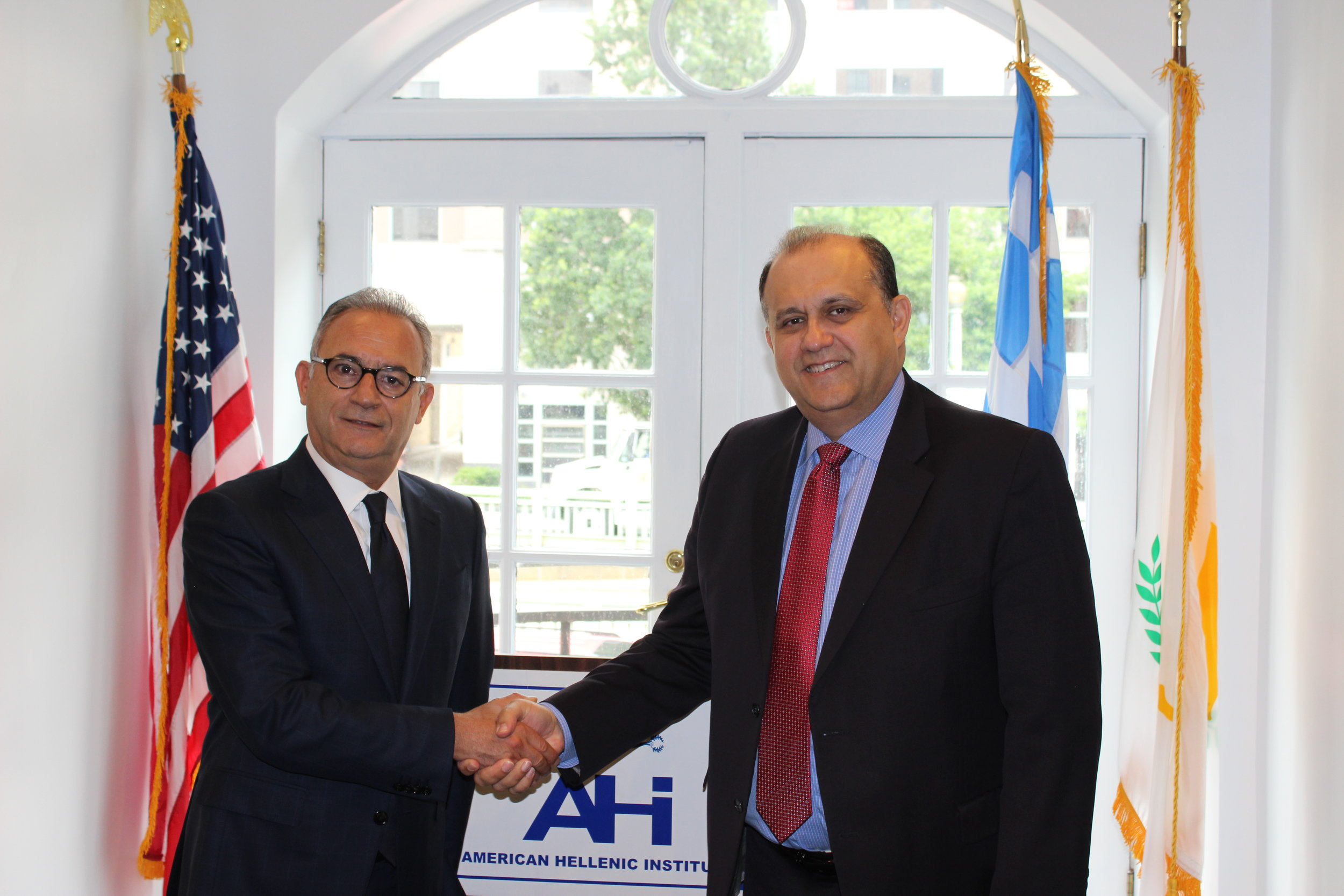 Mr. Averof Neophytou, President of Disy and Mr. Nick Larigakis, President of AHI.