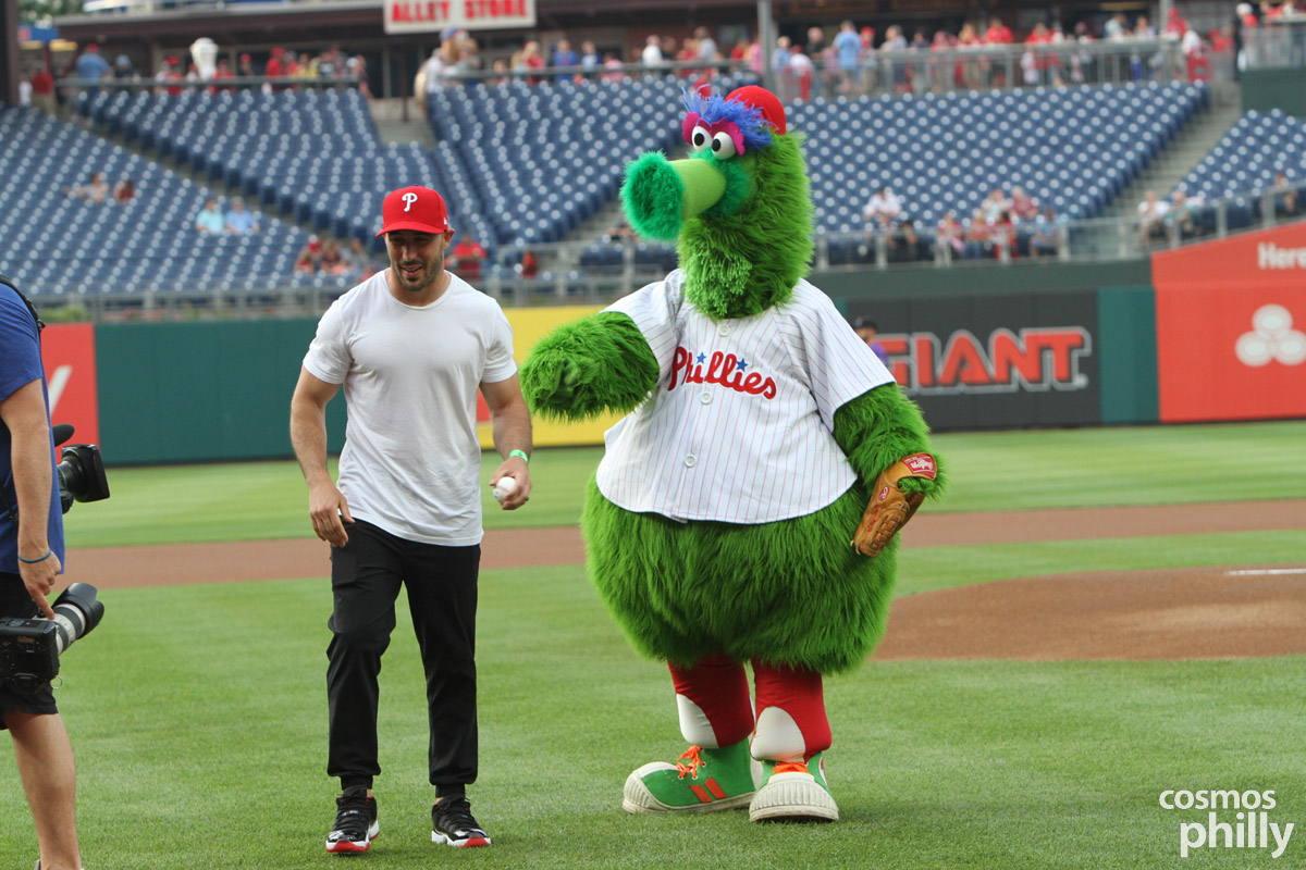 Super Bowl LII Champion Chris Maragos, defensive back, Philadelphia Eagles practices the first pitch with the Phillies Phanatic.